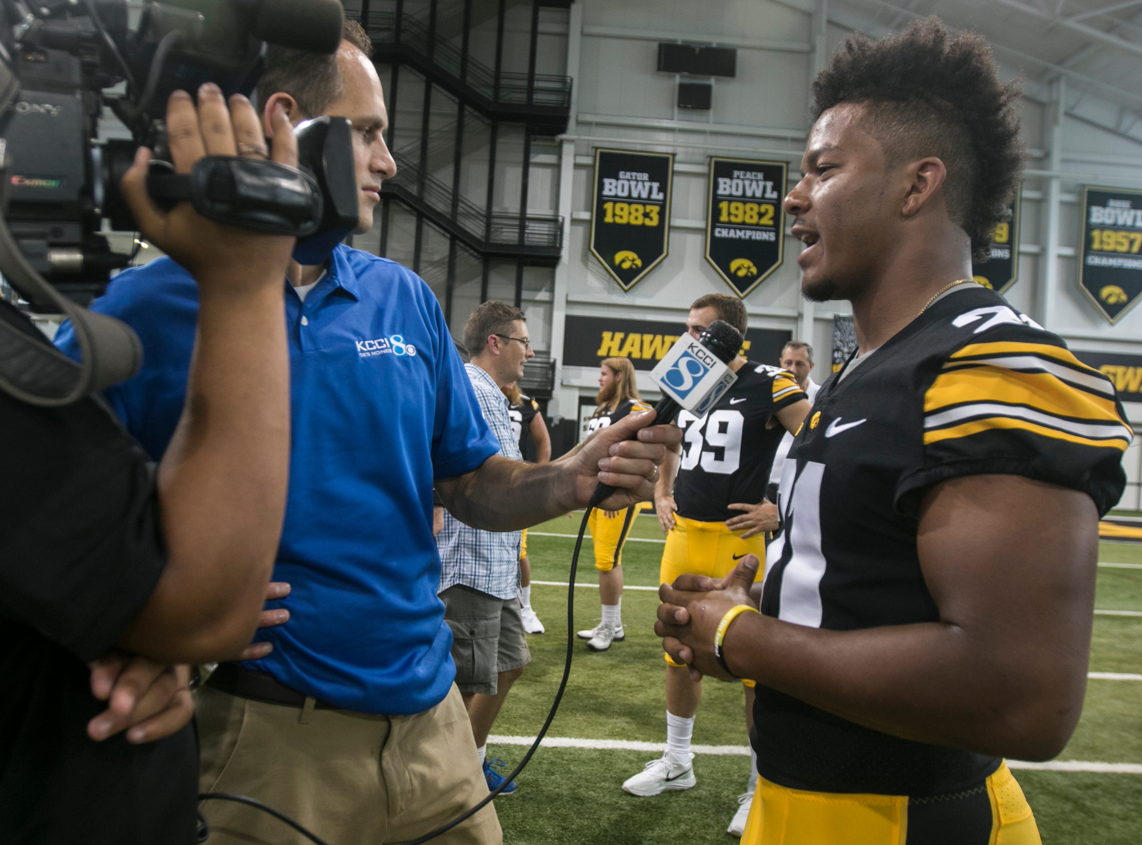 Iowa's Ivory Kelly-Martin talks with reporters during Iowa football media day on Friday, Aug. 10, 2018, in Iowa City.