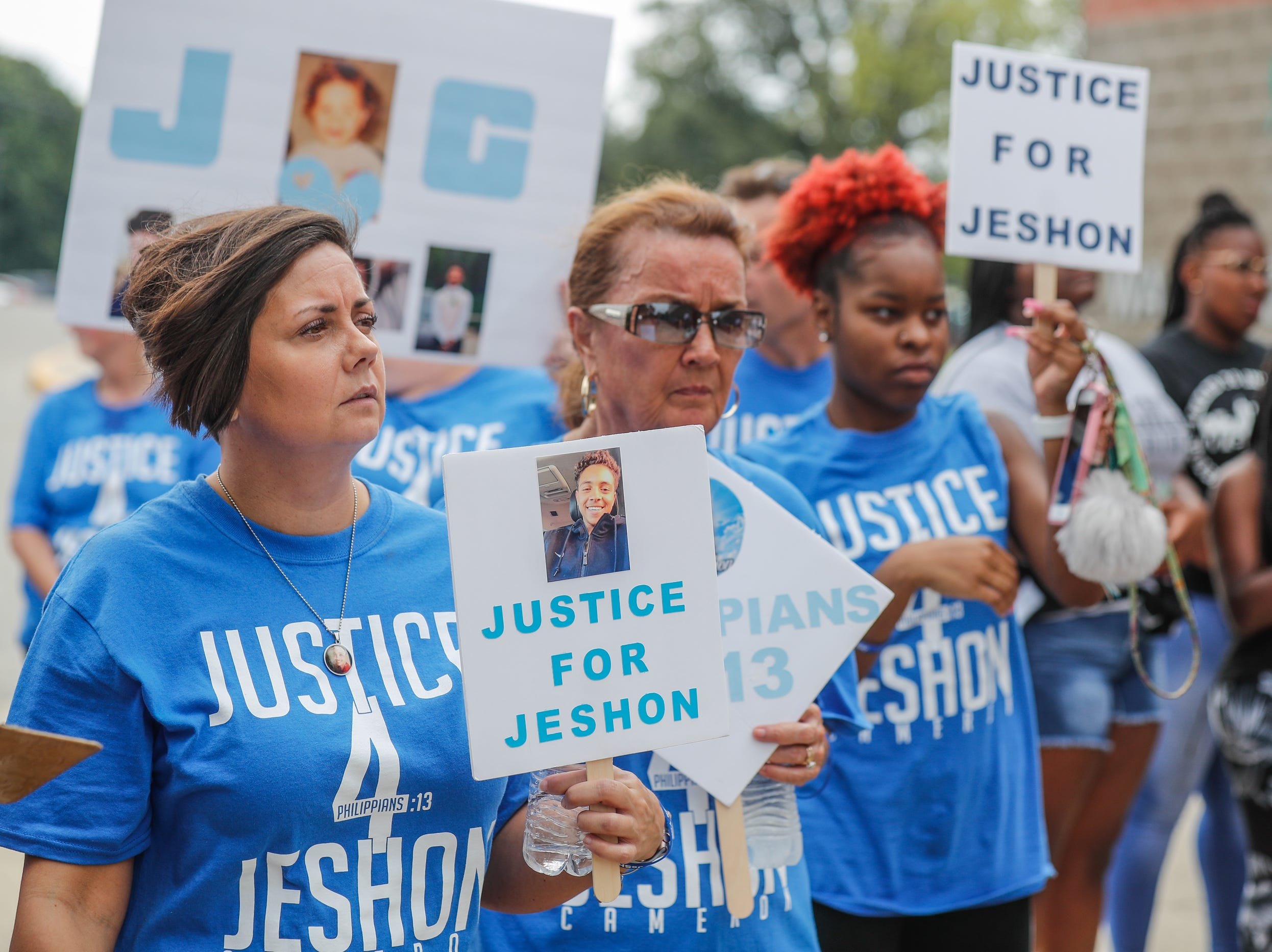 "Jennifer Cameron, left, the mother of JeShon Cameron who was killed in a July 16th shooting, attends the second annual 'We Live"" Peace Walk and Community Day to end youth violence at Washington Park on Saturday, Aug. 11, 2018. 'We Live,' which stands for 'Linked To Intercept Violence' was started by students from Warren Central High School in Indianapolis."