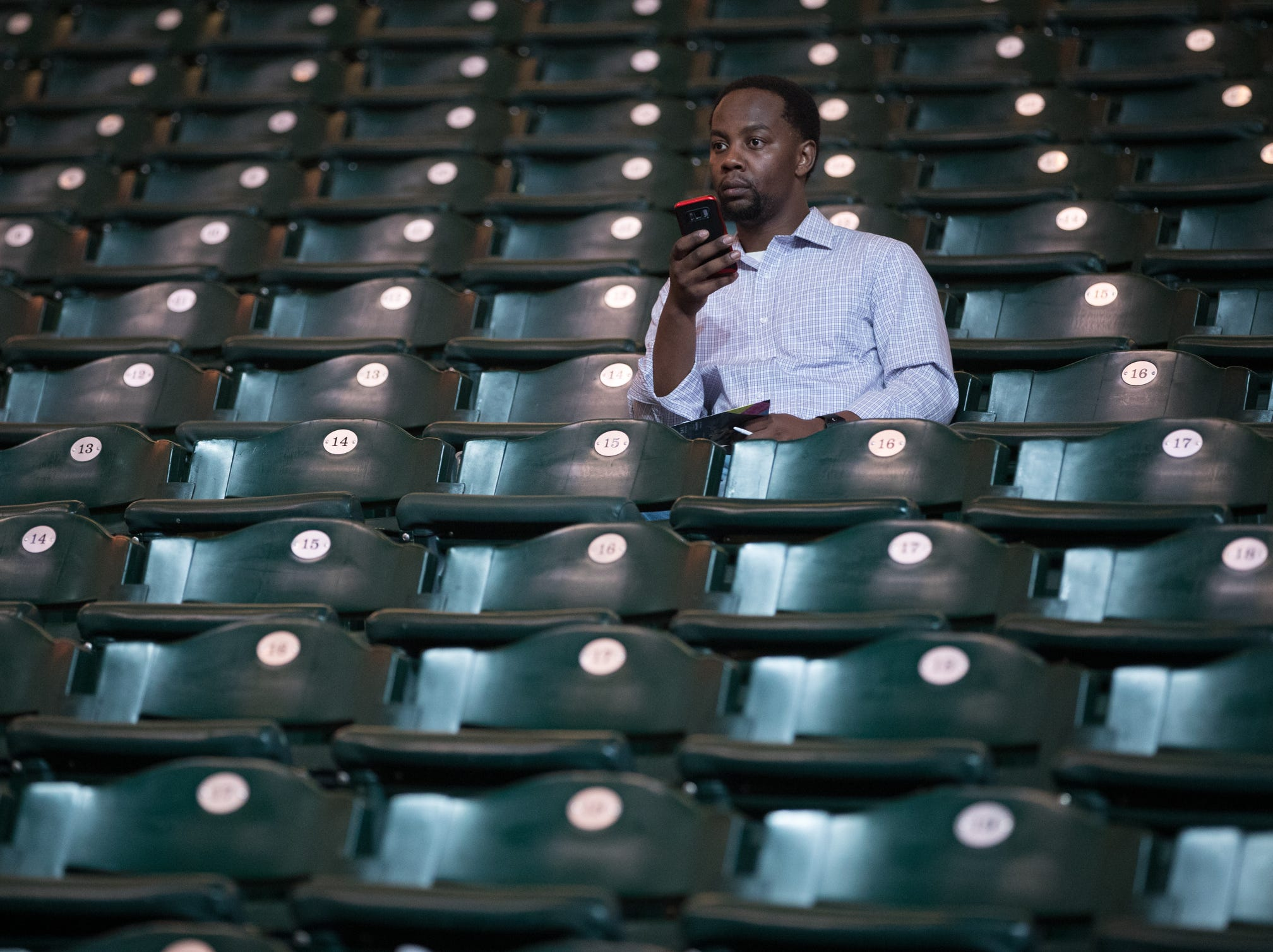 Martin Kirirah, Indianapolis, sits in the stands about an hour before the Joel Osteen event at Bankers Life Fieldhouse, Indianapolis, Friday, Aug. 10, 2018. The event, dubbed Night of Hope with Joel and Victoria, drew about 8,000 people to the arena for the event with the Houston-based televangelist.