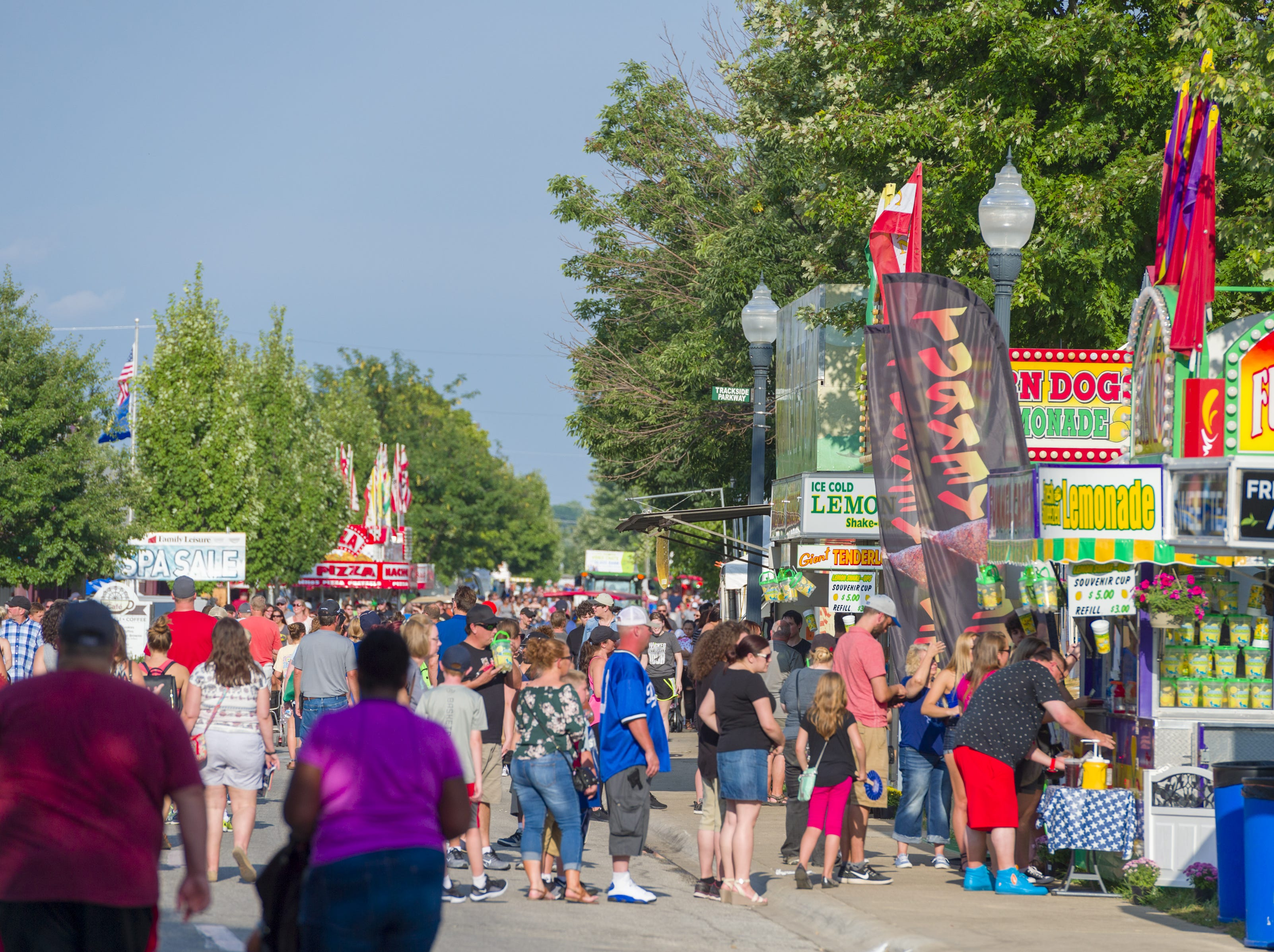 Fair goers line up at the various food vendors at the Indiana State Fair, Friday, Aug. 10, 2018, on the Chevrolet Free Stage.