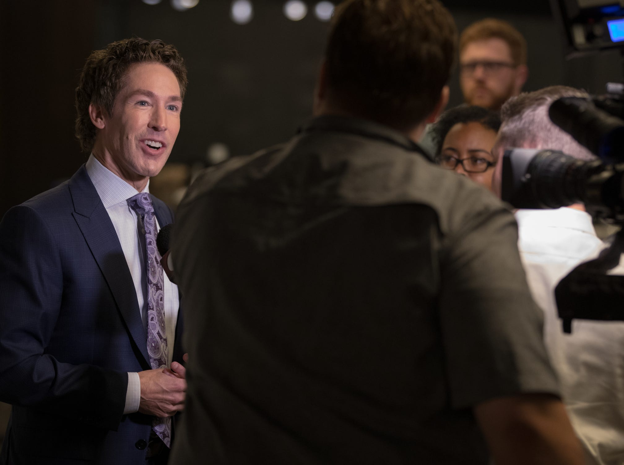 Joel Osteen talks with media members at Bankers Life Fieldhouse, Indianapolis, Friday, Aug. 10, 2018. The event, dubbed Night of Hope with Joel and Victoria, drew about 8,000 people to the arena for the event with the Houston-based televangelist.