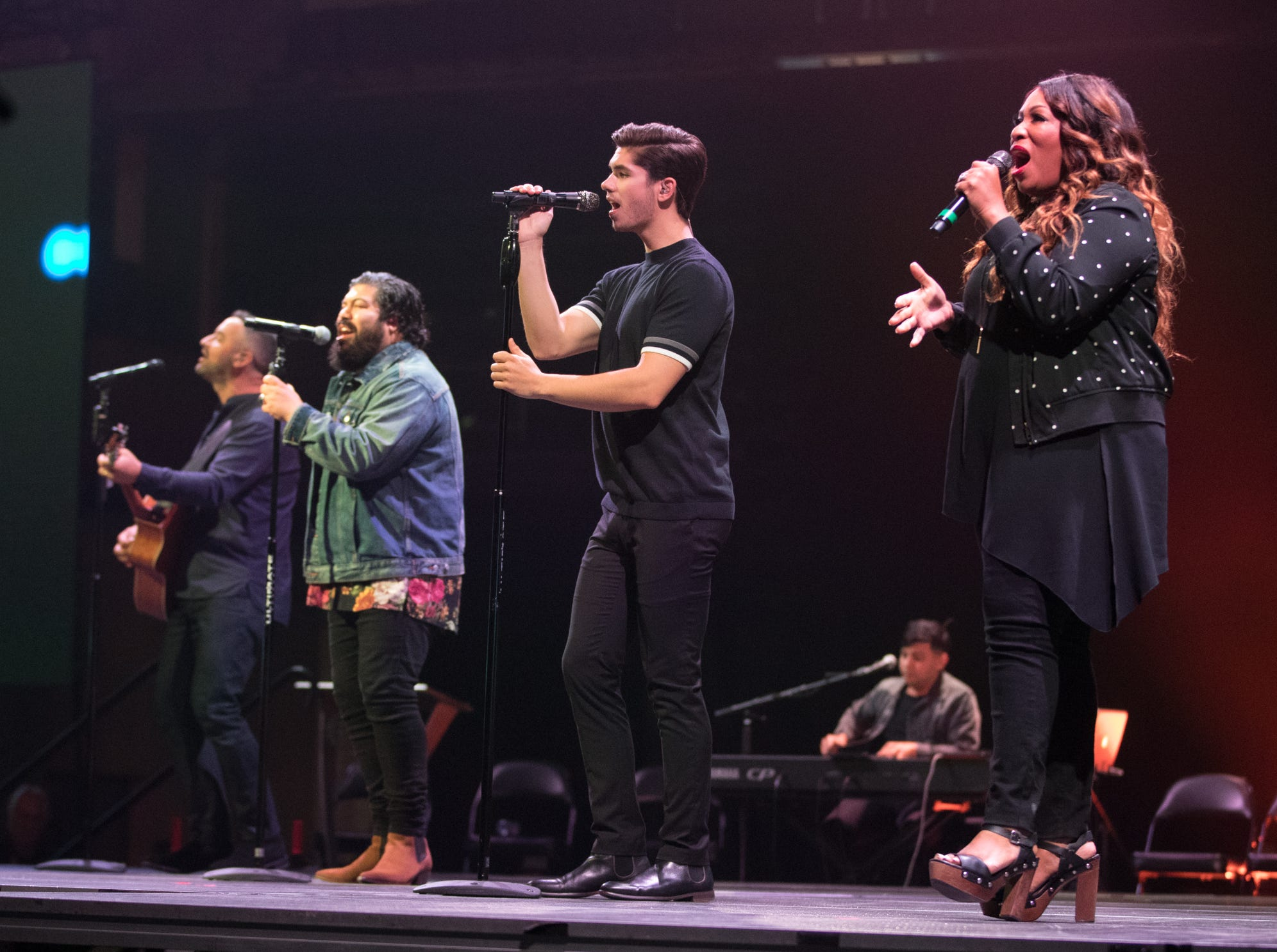 A warmup praise band entertains at Bankers Life Fieldhouse, Indianapolis, Friday, Aug. 10, 2018. The event, dubbed Night of Hope with Joel and Victoria, drew about 8,000 people to the arena for the event with the Houston-based televangelist.