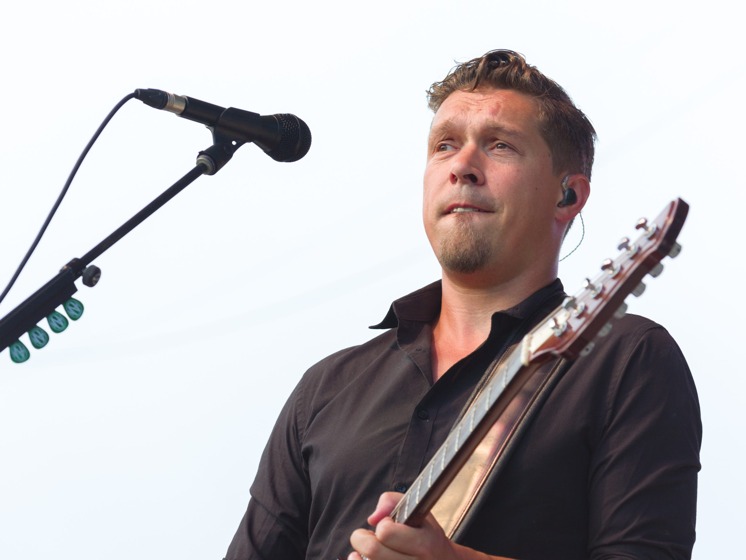 """Isaac Hanson, guitarist, performs on stage. Hanson, a trio of siblings known for the No. 1 hit in 1997 titled """"MMMBop"""" performed at the Indiana State Fair, Friday, Aug. 10, 2018, on the Chevrolet Free Stage."""