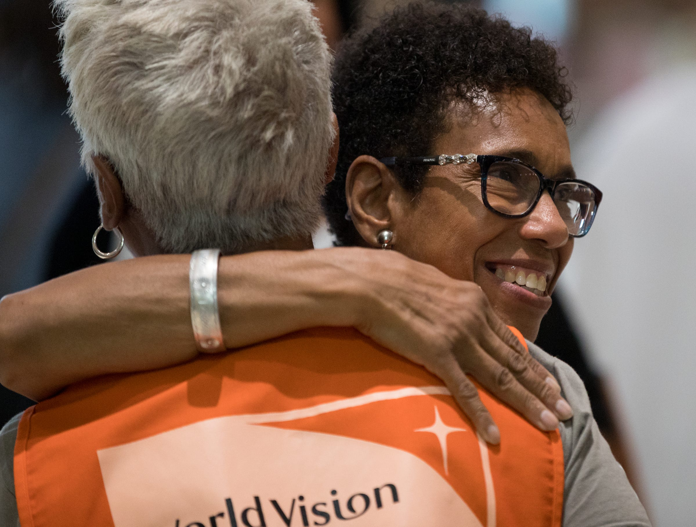 Agnes Shelton (right) gives a hug to Sabae Martin, both of Indianapolis, about an hour before the Osteen event at Bankers Life Fieldhouse, Indianapolis, Friday, Aug. 10, 2018. The event, dubbed Night of Hope with Joel and Victoria, drew about 8,000 people to the arena for the event with the Houston-based televangelist.