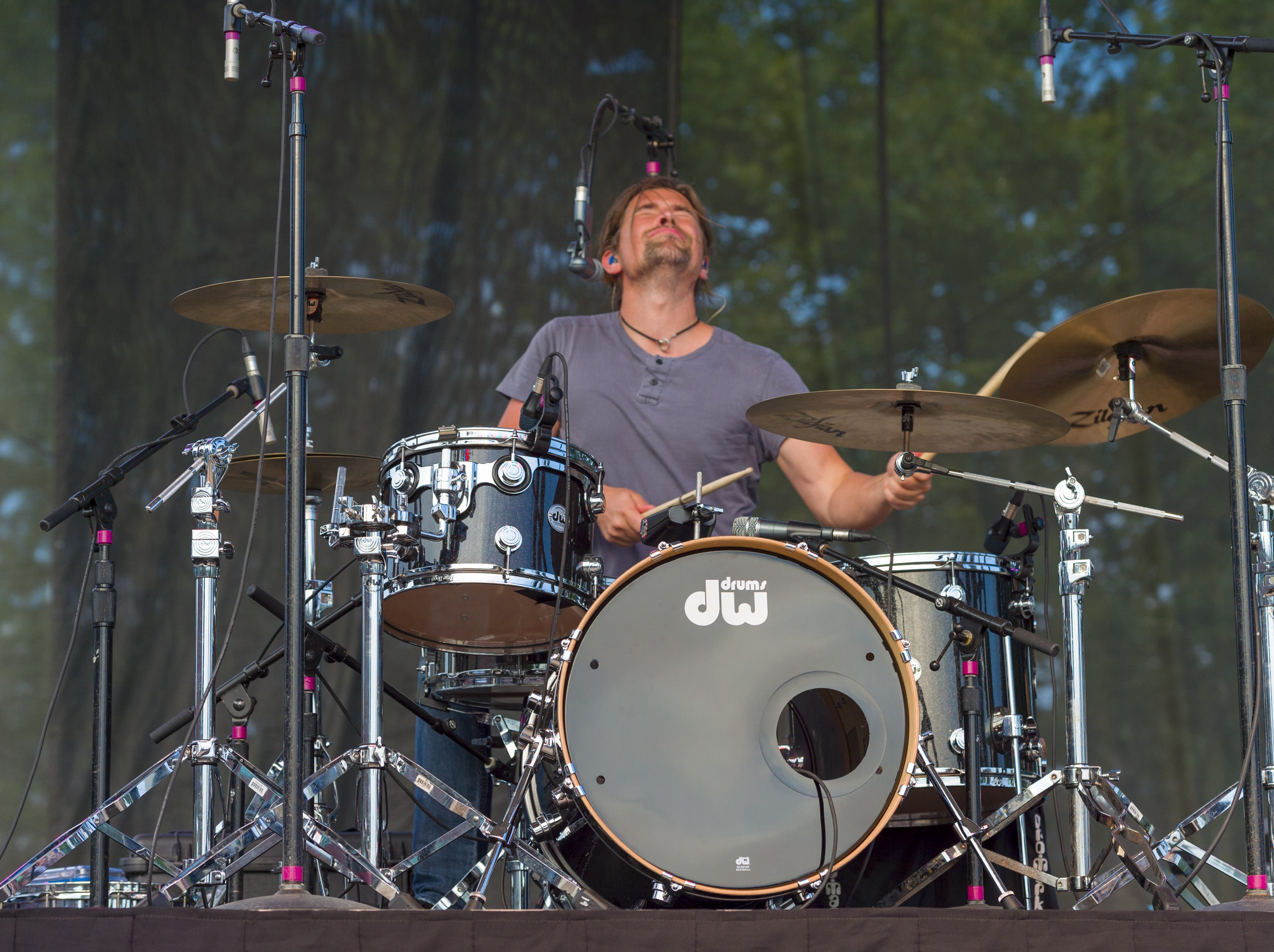 "Zac Hanson, drummer, performs on stage. Hanson, a trio of siblings known for the No. 1 hit in 1997 titled ""MMMBop"" performed at the Indiana State Fair, Friday, Aug. 10, 2018, on the Chevrolet Free Stage."
