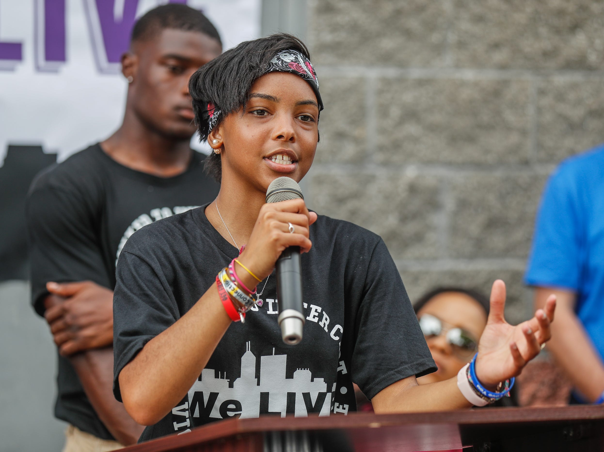 Destiny Hatcher, who lost her uncle and friend JeShon Cameron to youth gun violence emcees the second annual 'We Live,' Peace Walk and Community Day to end youth violence at Washington Park on Saturday, Aug. 11, 2018. 'We Live,' which stands for 'Linked To Intercept Violence' was started by students from Warren Central High School in Indianapolis.