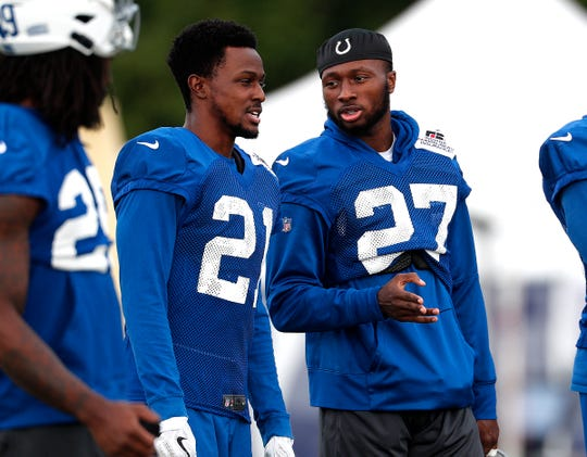 Indianapolis Colts cornerback Nate Hairston (27) talks with D.J. White (21) during their preseason training camp at Grand Park in Westfield on Saturday, August 11, 2018.