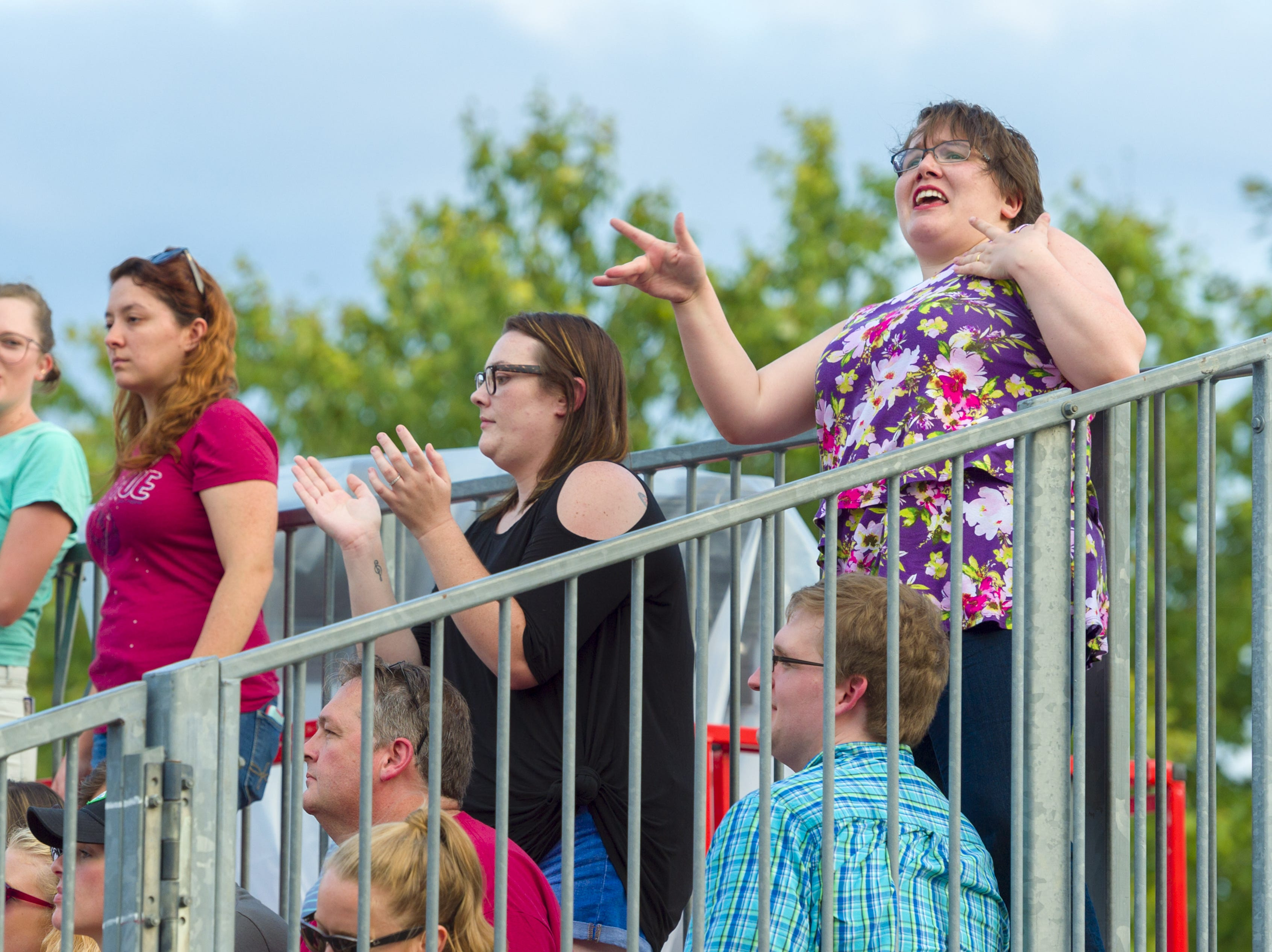 "Emily Maduzia, of Urbana, Ill., sings and dances along with the music of Hanson. Hanson, a trio of siblings known for the No. 1 hit in 1997 titled ""MMMBop"" performed at the Indiana State Fair, Friday, Aug. 10, 2018, on the Chevrolet Free Stage."