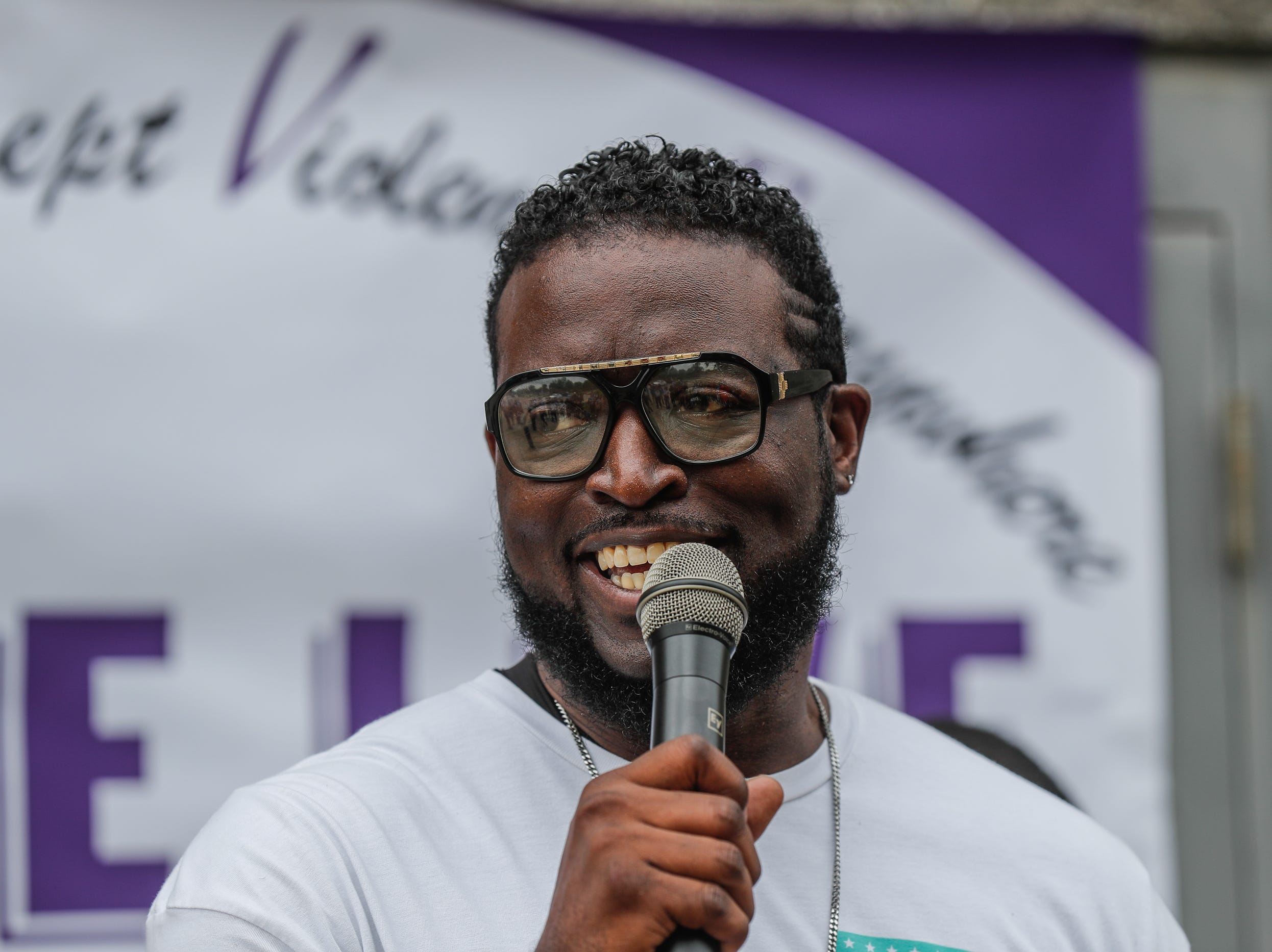 Keenan Young speaks during the second annual 'We Live' Peace Walk and community day to end youth violence at Washington Park on Saturday, Aug. 11, 2018. 'We Live,' which stands for 'Linked To Intercept Violence' was started by students from Warren Central High School in Indianapolis.