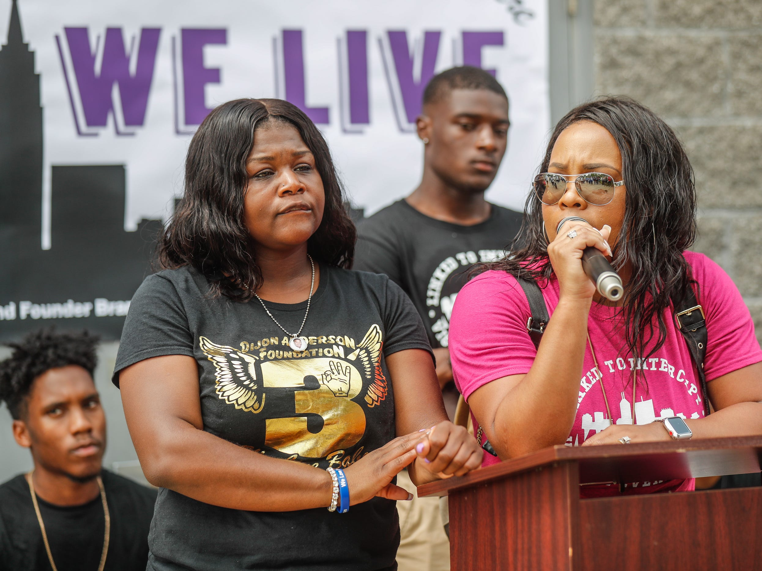 Christa Frazier, mother of Dijon Anderson, a Warren Central High School student who was killed in 2017, left, and Ursula Washington, a licensed Funeral Director and embalmer, speak during the second annual 'We Live' Peace Walk and Community Day to end youth violence at Washington Park on Saturday, Aug. 11, 2018. 'We Live,' which stands for 'Linked To Intercept Violence' was started by students from Warren Central High School in Indianapolis.