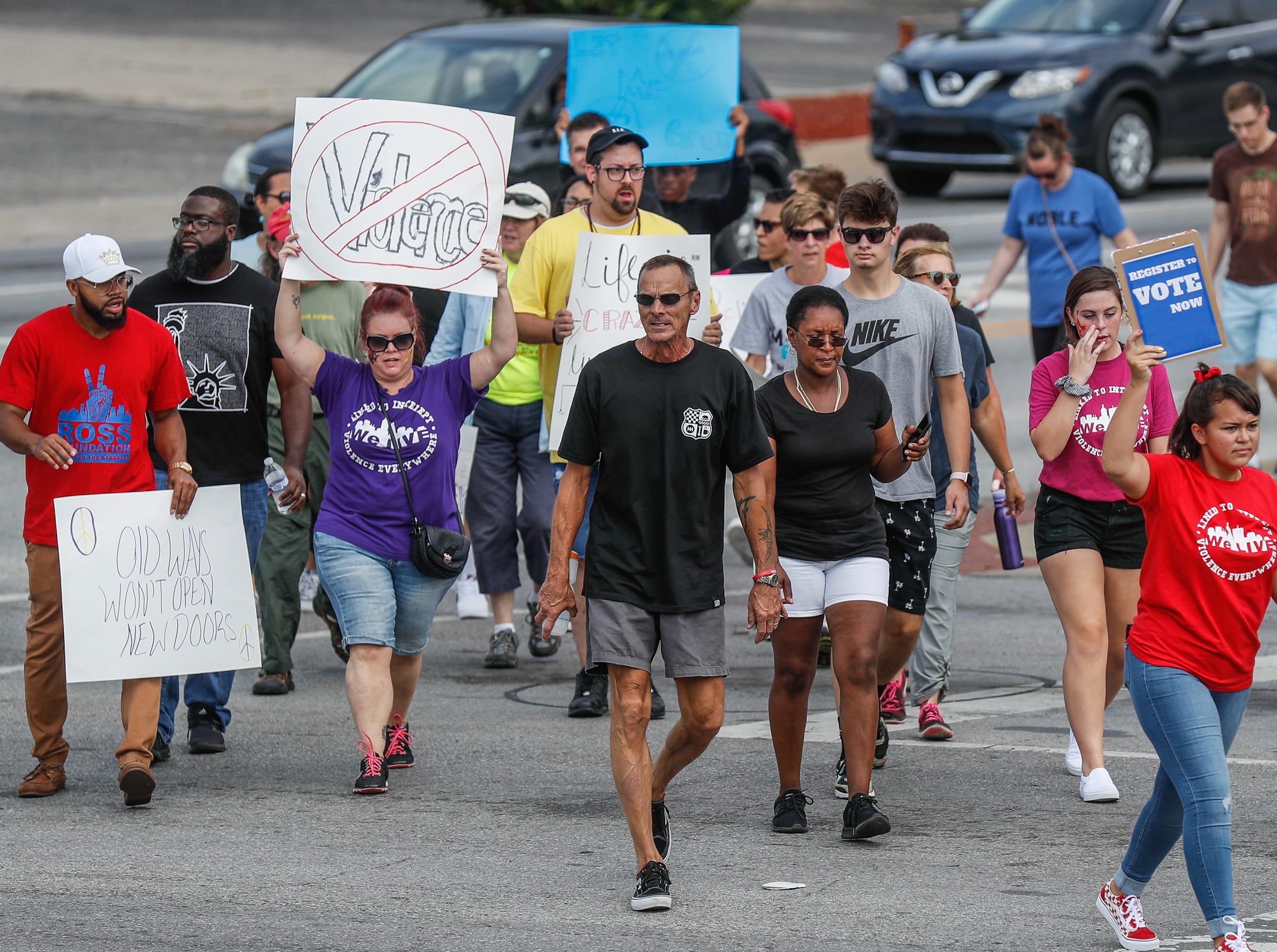 Members and supporters of 'We Live', gathered for their second annual Peace Walk and Community Day to end youth violence at Washington Park on Saturday, Aug. 11, 2018. 'We Live,' which stands for 'Linked To Intercept Violence' was started by students from Warren Central High School in Indianapolis.