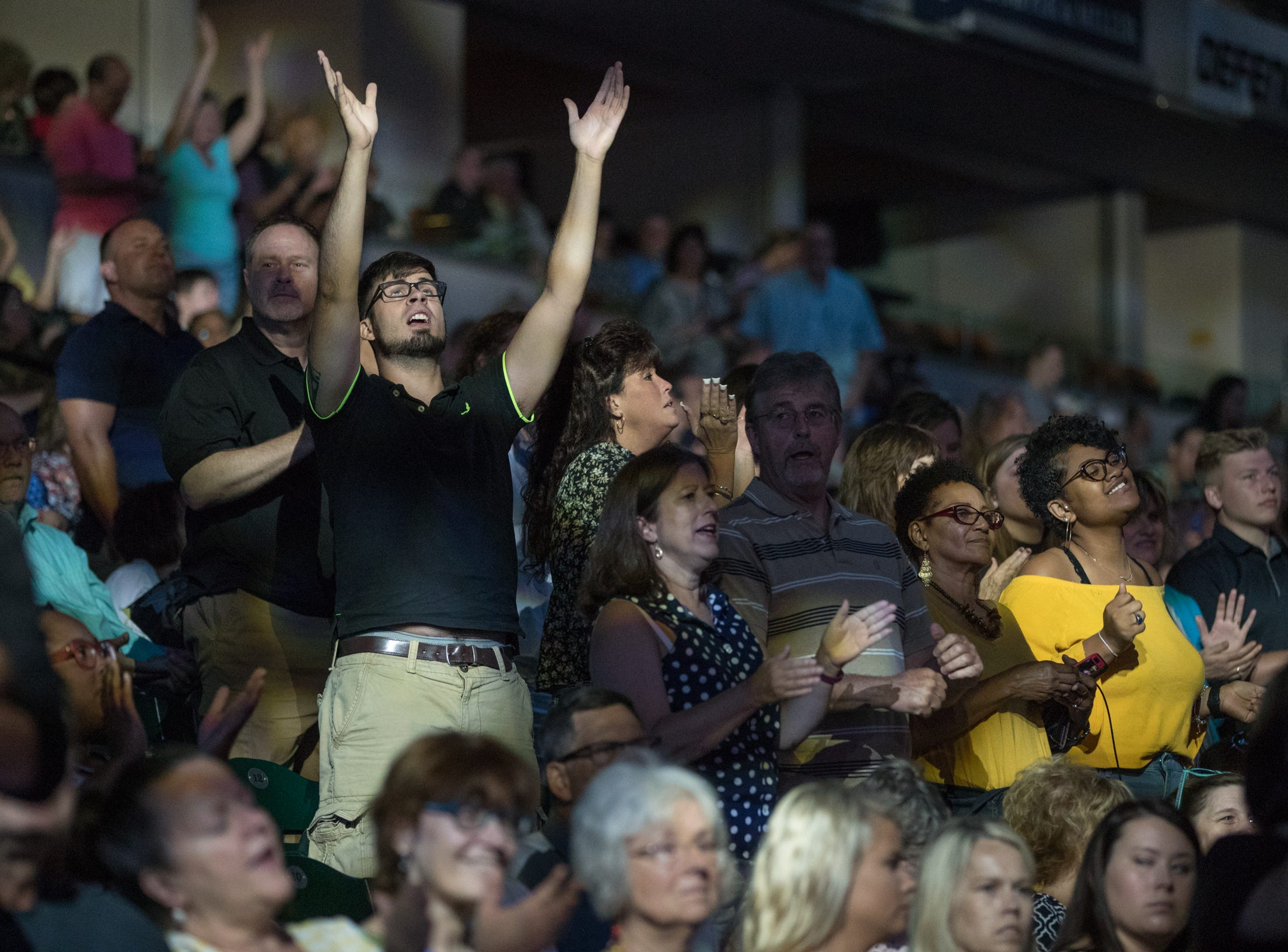 Fans watch a praise band play at Bankers Life Fieldhouse, Indianapolis, Friday, Aug. 10, 2018. The event, dubbed Night of Hope with Joel and Victoria, drew about 8,000 people to the arena for the event with the Houston-based televangelist.