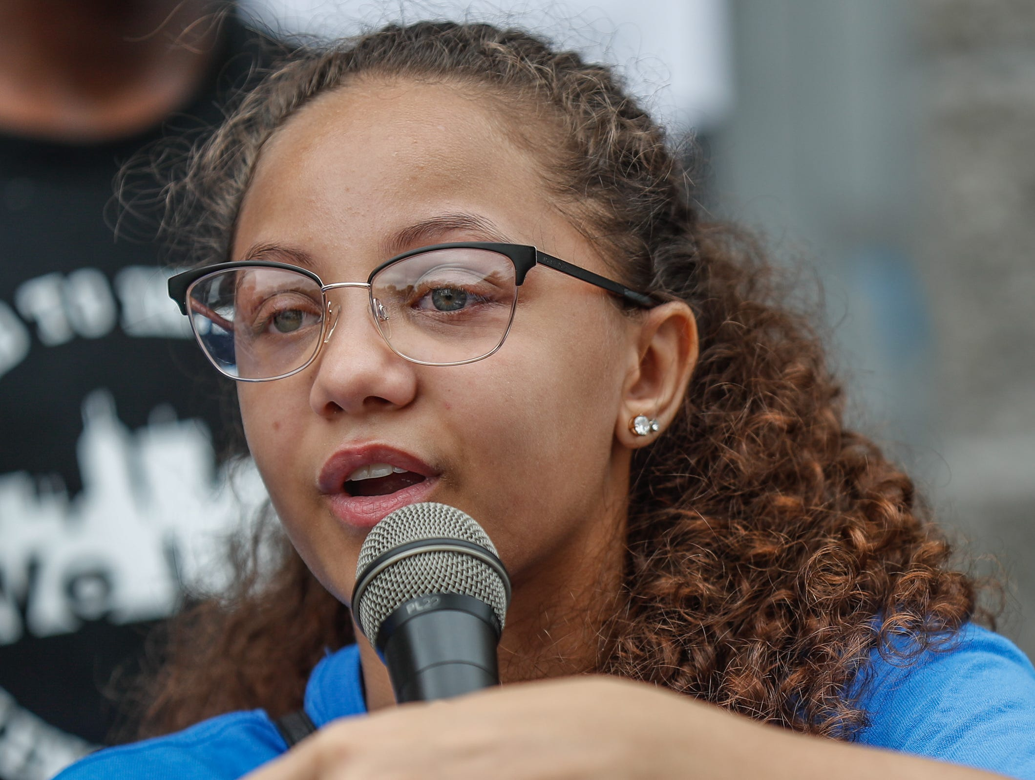 Amaia Cameron, the sister of JeShon Cameron who was killed July 16, 2018, speaks during the second annual 'We Live' Peace Walk and Community Day to end youth violence at Washington Park on Saturday, Aug. 11, 2018. 'We Live,' which stands for 'Linked To Intercept Violence' was started by students from Warren Central High School in Indianapolis.