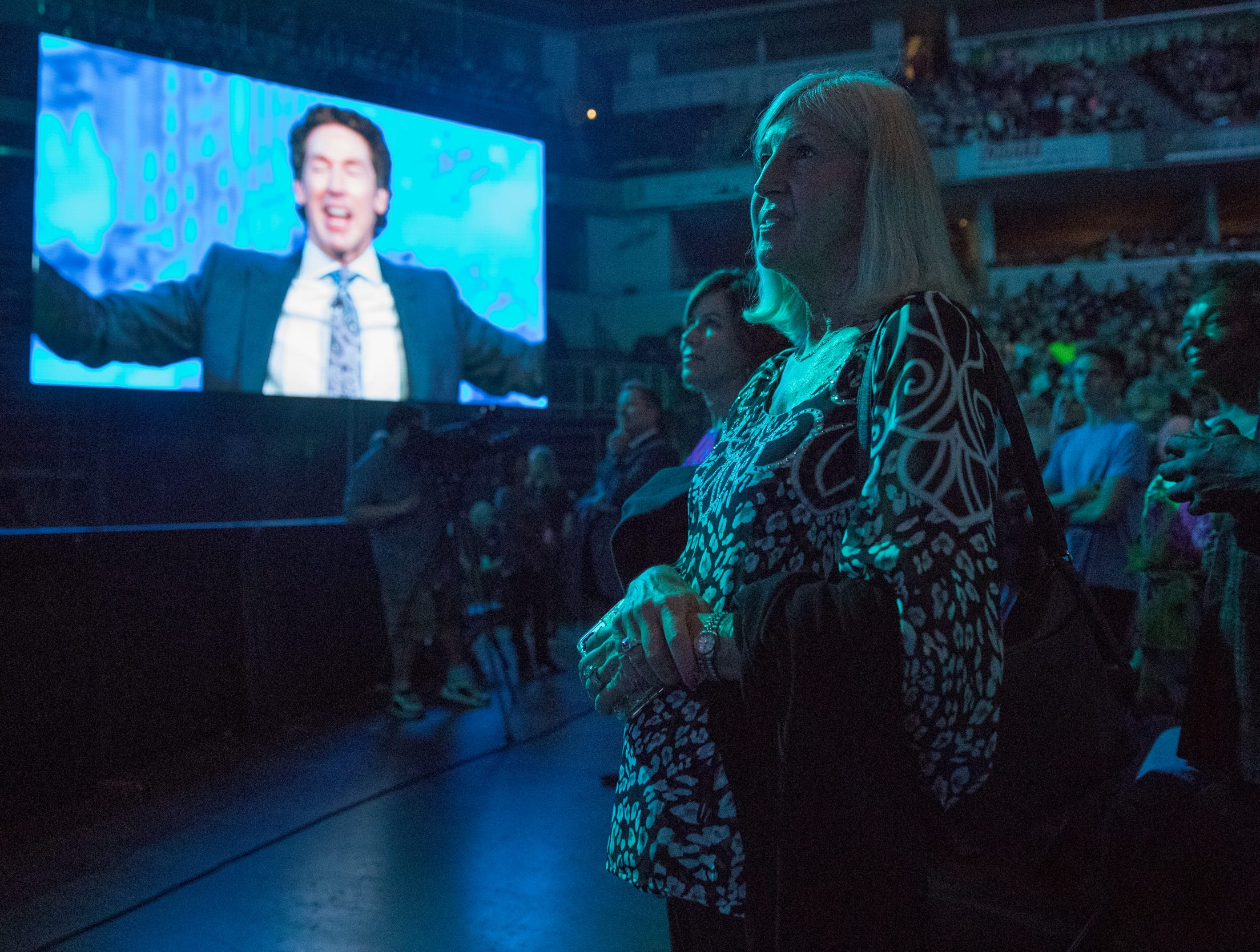 Fans watch as Joel Osteen speaks at Bankers Life Fieldhouse, Indianapolis, Friday, Aug. 10, 2018. The event, dubbed Night of Hope with Joel and Victoria, drew about 8,000 people to the arena for the event with the Houston-based televangelist.
