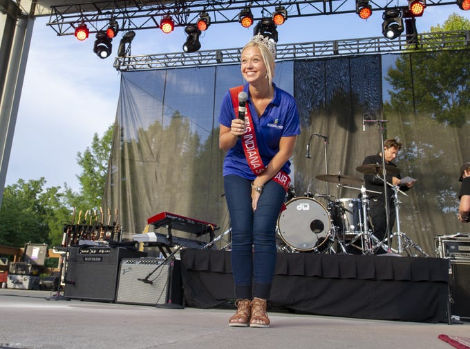 """Audrey Campbell, Miss Fountain County and the 60th Indiana State Fair Queen introduces the headline act onto the stage. Hanson, a trio of siblings known for the No. 1 hit in 1997 titled """"MMMBop"""" performed at the Indiana State Fair, Friday, Aug. 10, 2018, on the Chevrolet Free Stage."""
