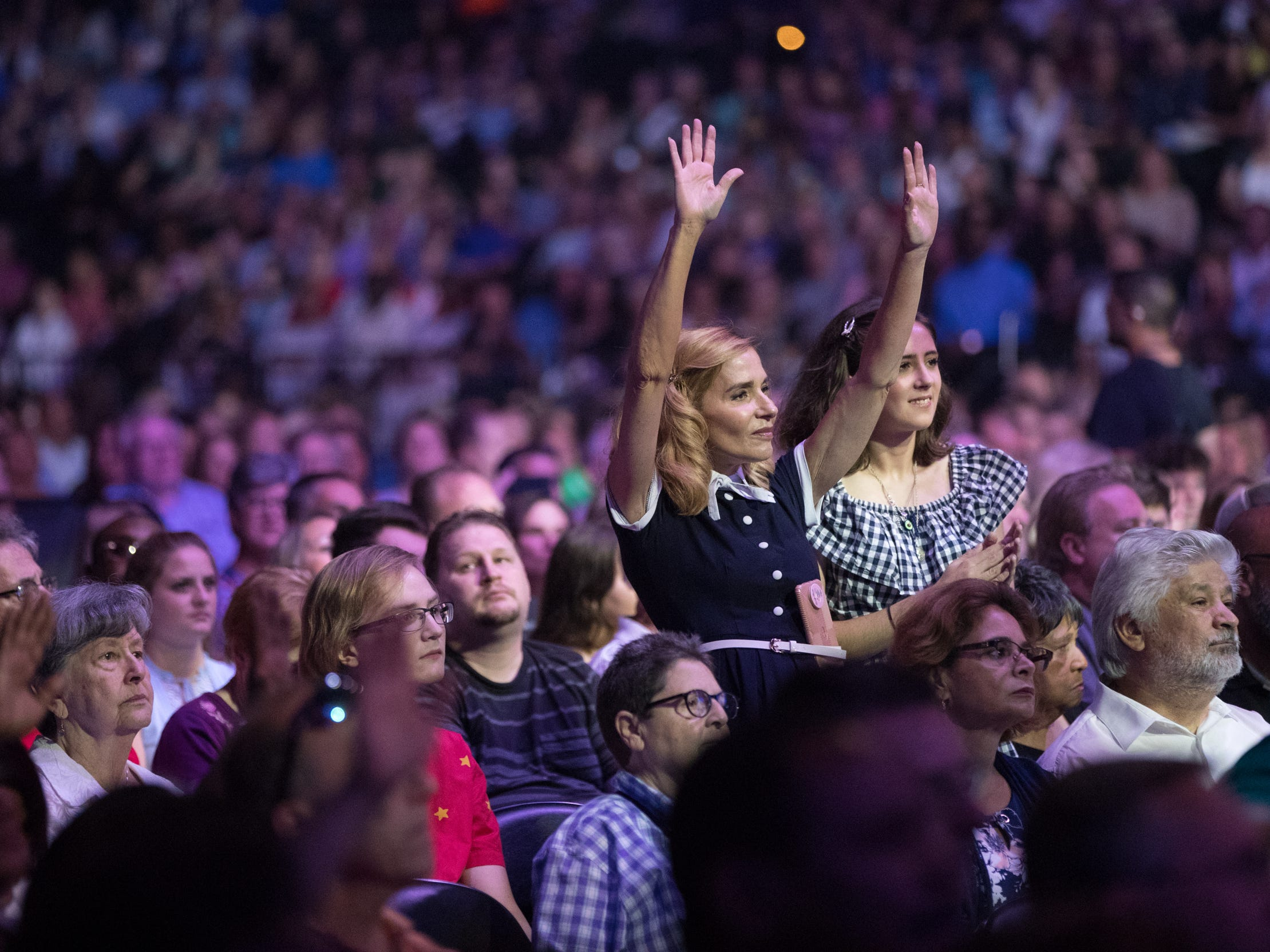 The audience watches a praise band performance at Bankers Life Fieldhouse, Indianapolis, Friday, Aug. 10, 2018. The event, dubbed Night of Hope with Joel and Victoria, drew about 8,000 people to the arena for the event with the Houston-based televangelist.