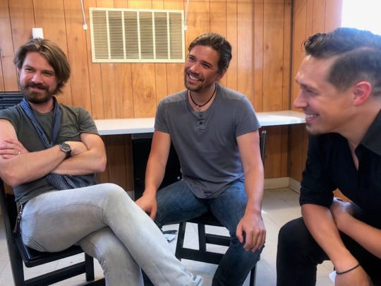 Taylor, Zac and Isaac Hanson talk with before their show on the Chevrolet Free Stage at the Indiana State Fair.