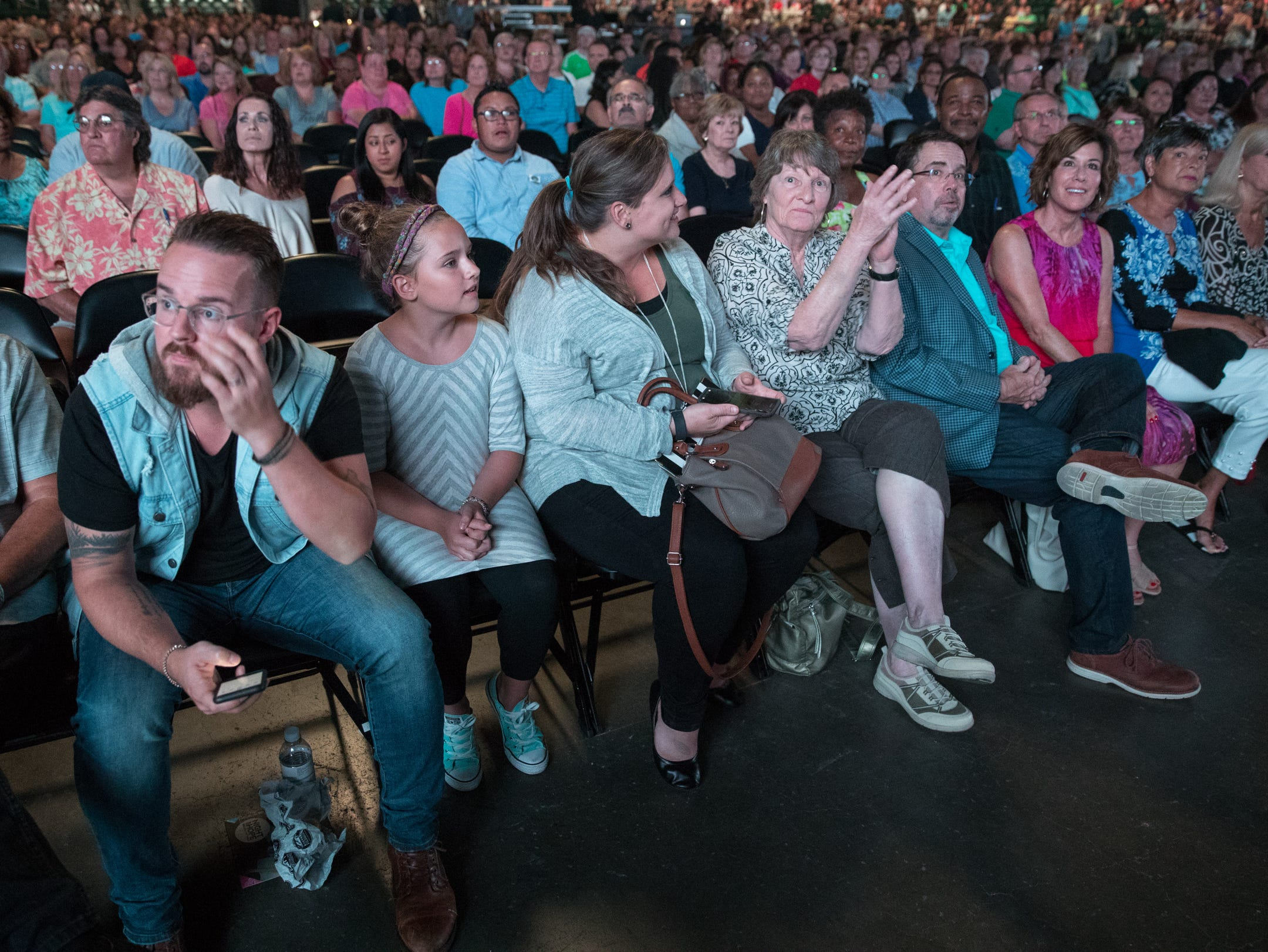 Fans wait for the start of the Osteen event at Bankers Life Fieldhouse, Indianapolis, Friday, Aug. 10, 2018. The event, dubbed Night of Hope with Joel and Victoria, drew about 8,000 people to the arena for the event with the Houston-based televangelist.