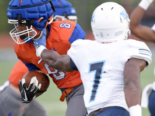 Madison Central's Myles Hopson (8) runs through an arm tackle by Ridgeland's Michael Smith (7) on Friday, August 10, 2018, at the Madison County Football Jamboree at Ridgeland High School in Ridgeland, Miss.