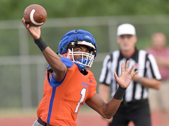 Madison Central quarterback Jimmy Holiday (1) throws to the sideline against the Titans on Friday, August 10, 2018, at the Madison County Football Jamboree at Ridgeland High School in Ridgeland, Miss.