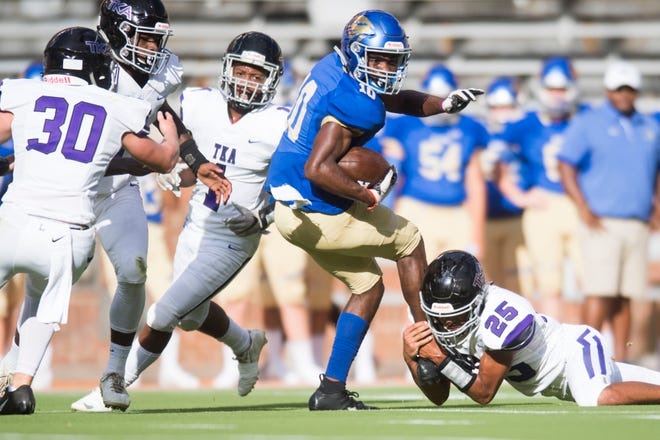 Karns' Thomas Harper (10) is taken down by TKA's Tommy Gagne (25) at the KOC Kick-off Classic at Neyland Stadium, Friday, Aug. 10, 2018.