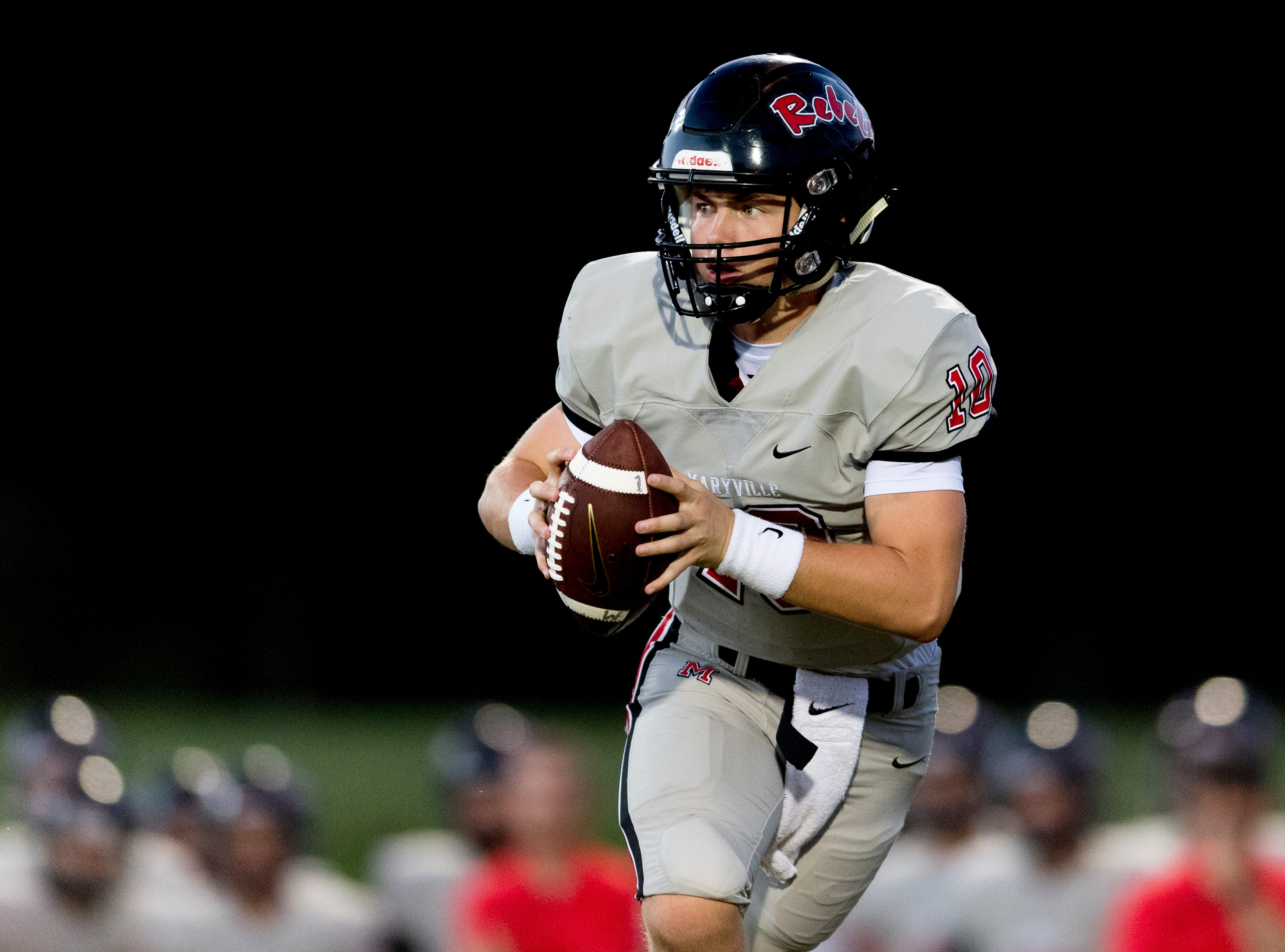Maryville's Braden Carnes (10) looks to pass during the Blount County football jamboree at William Blount High School in Maryville, Tennessee on Friday, August 10, 2018.