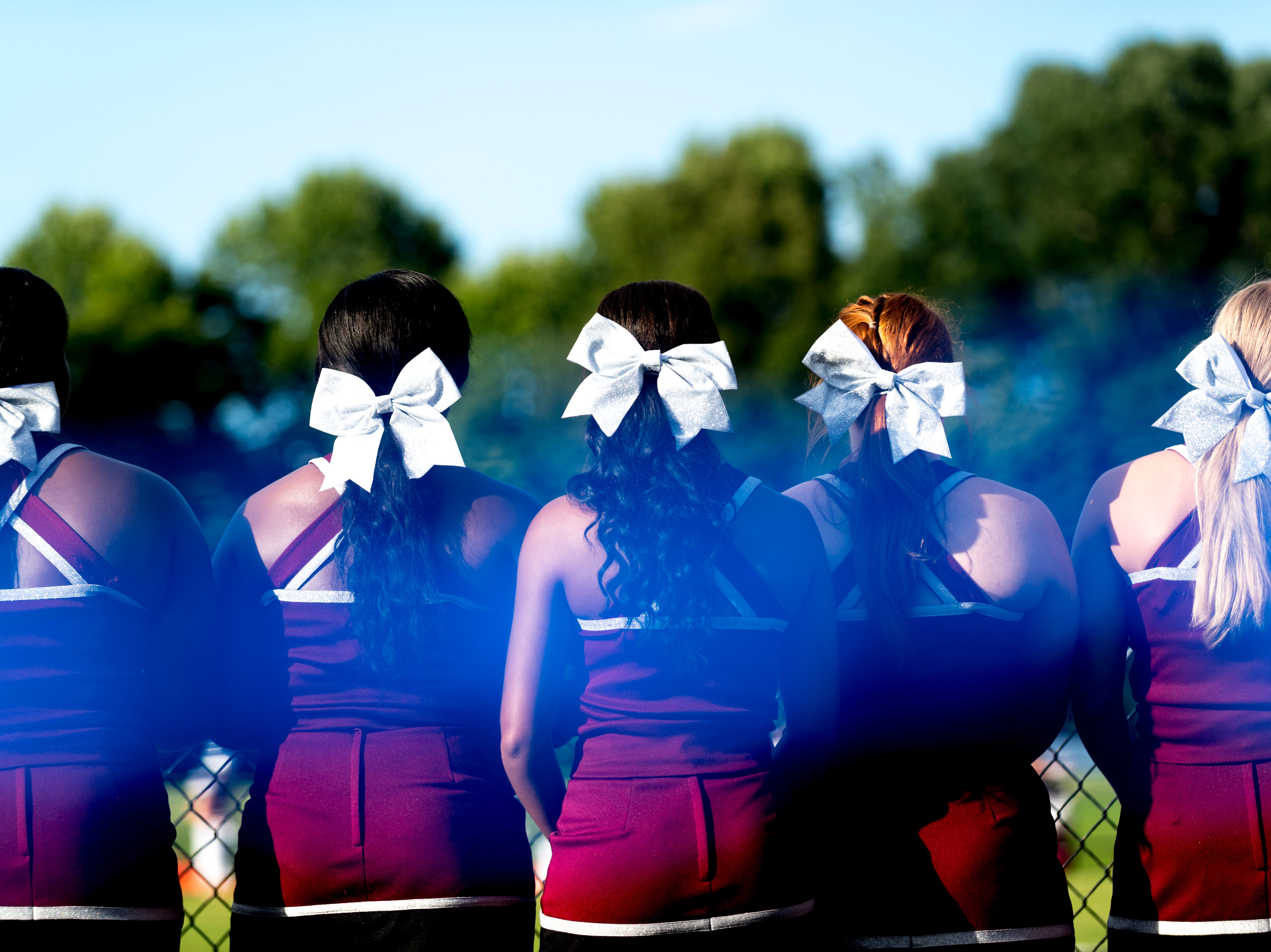 Alcoa cheerleaders watch the action from the sidelines during the Blount County football jamboree at William Blount High School in Maryville, Tennessee on Friday, August 10, 2018.