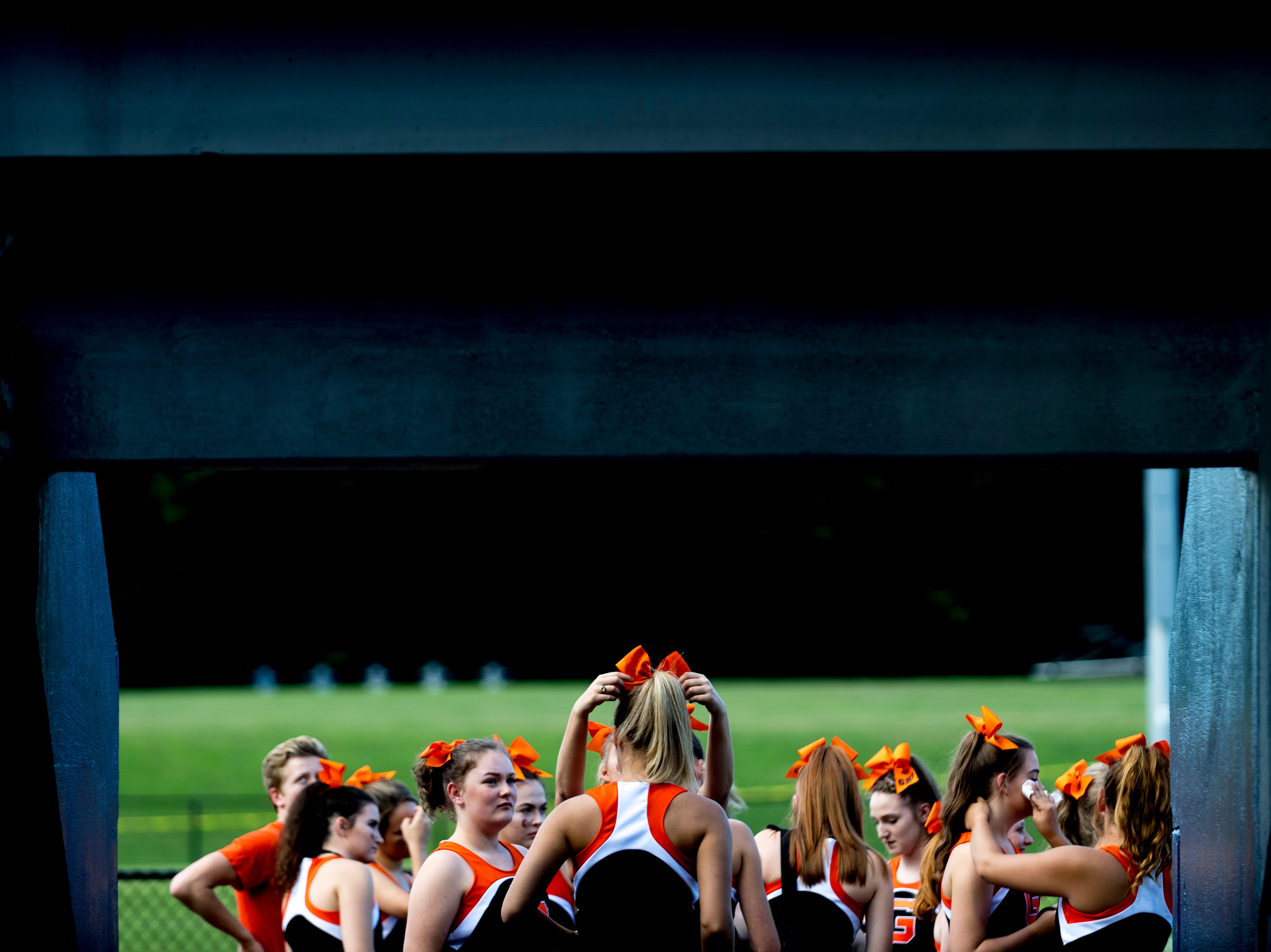Greenback cheerleaders get ready during the Blount County football jamboree at William Blount High School in Maryville, Tennessee on Friday, August 10, 2018.