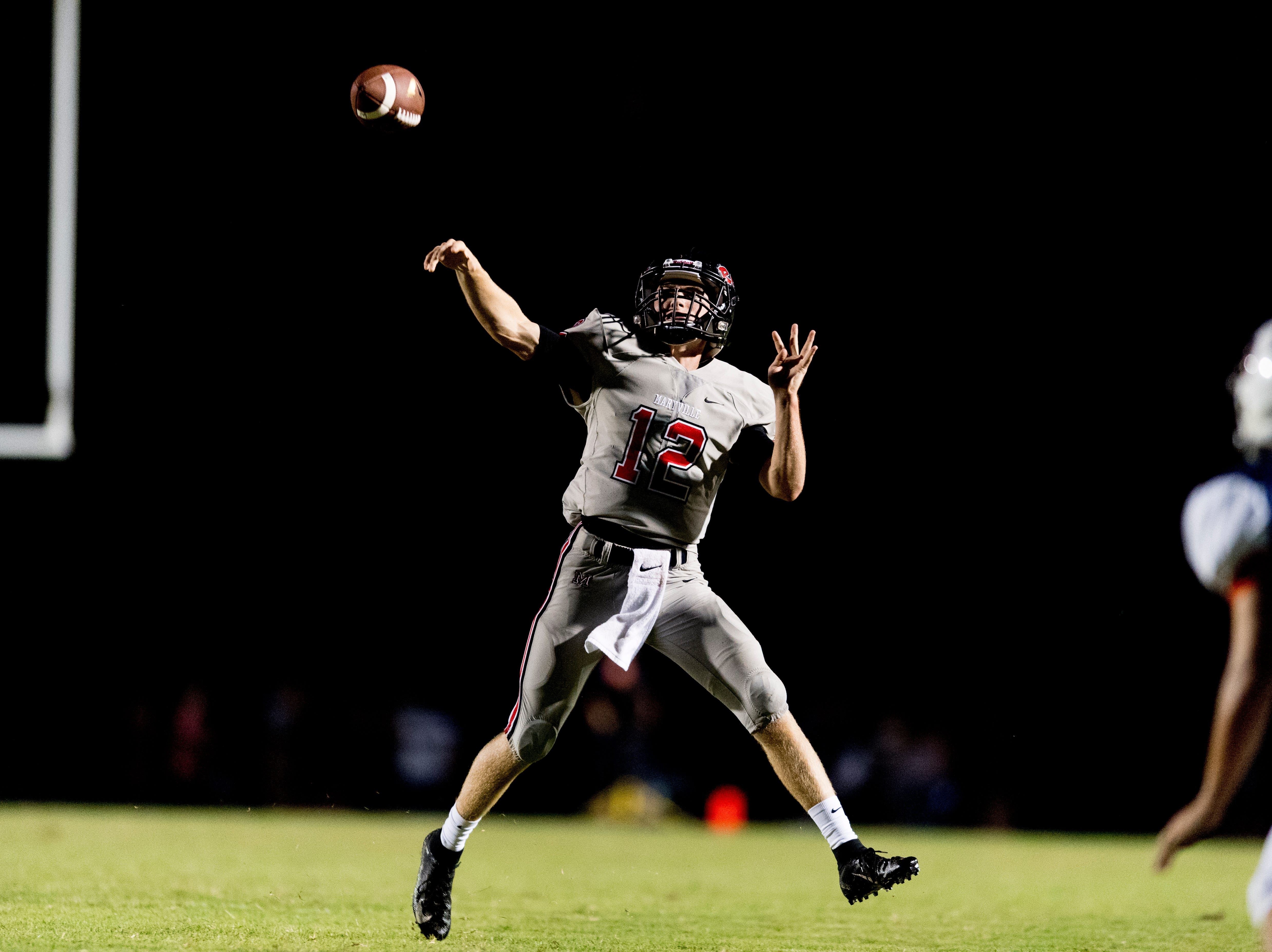 Maryville's Tanner Shiver (12) throws a pass during the Blount County football jamboree at William Blount High School in Maryville, Tennessee on Friday, August 10, 2018.
