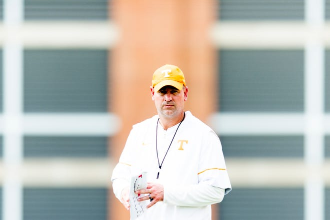 Tennessee Head Coach Jeremy Pruitt walks down the field during Tennessee football practice at Haslam Field in Knoxville, Tennessee on Saturday, August 11, 2018.