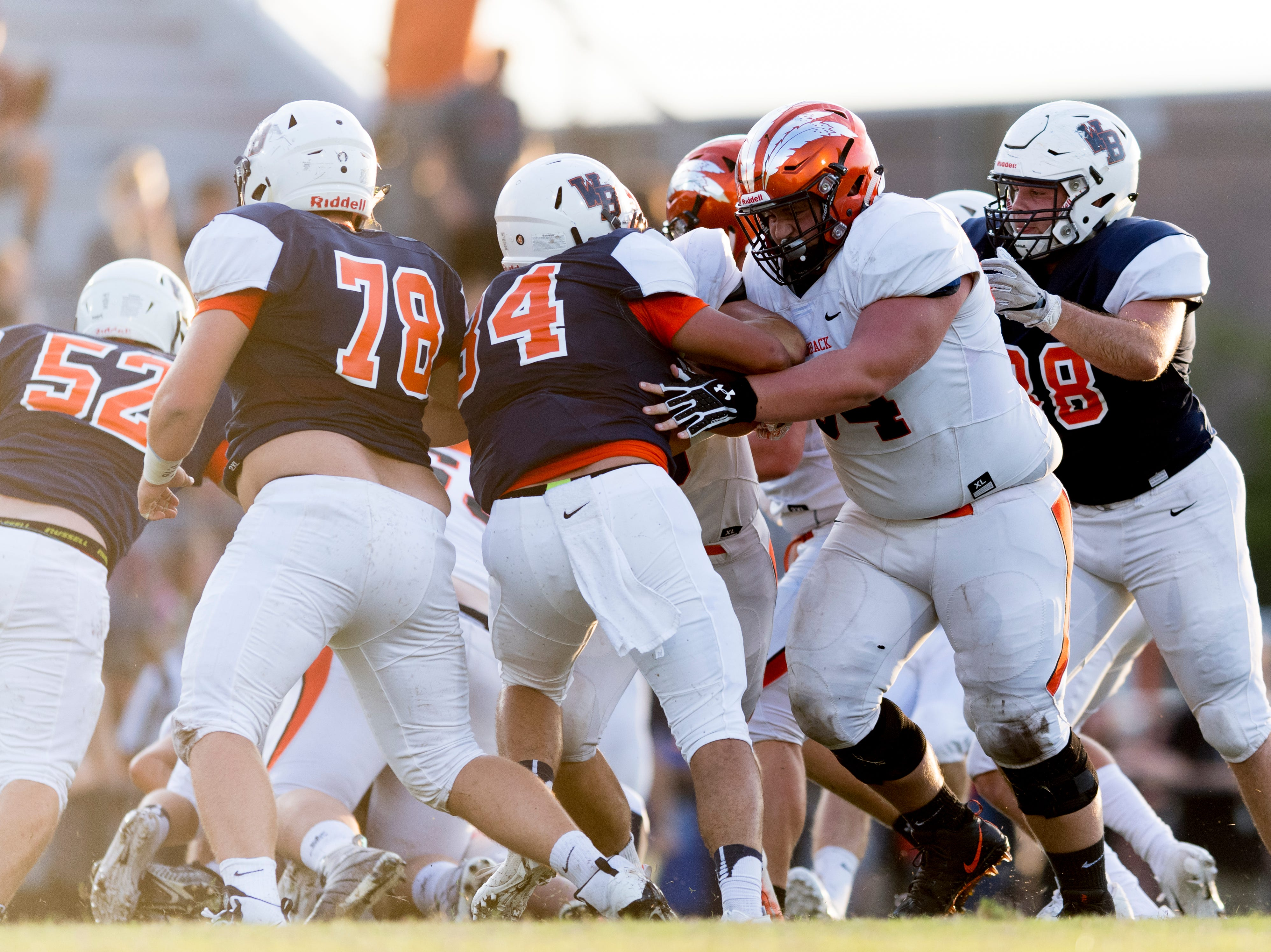 Greenback and William Blount players tackle one another during the Blount County football jamboree at William Blount High School in Maryville, Tennessee on Friday, August 10, 2018.