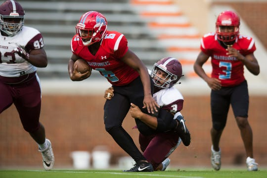 Austin-East's Trey Foster (6) runs the ball as Bearden's Condredge Holloway (3) tries to stop him at the KOC Kick-off Classic at Neyland Stadium, Friday, Aug. 10, 2018.