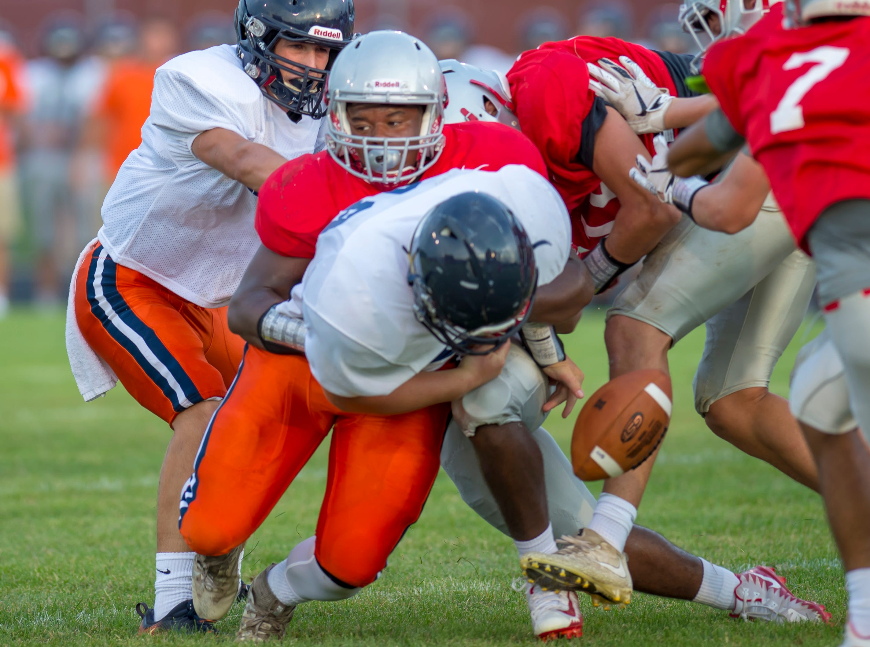 Lamont Johnson forces a fumble in the football scrimmage between the Harrison Raiders and the West Lafayette Red Devils from Gordon Straley Field