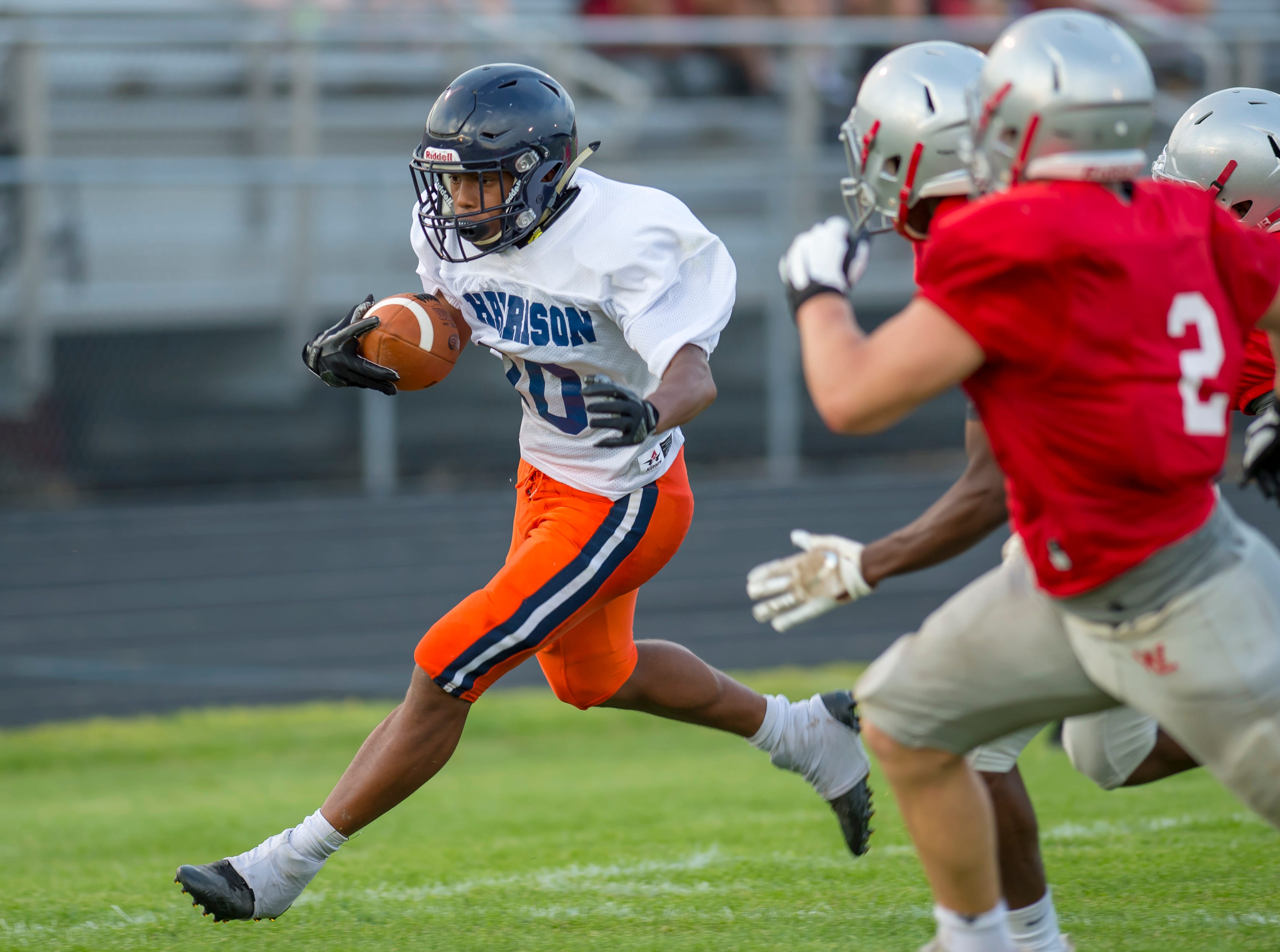 Isaiah Armstrong speeds down the sideline during the football scrimmage between the Harrison Raiders and the West Lafayette Red Devils from Gordon Straley Field