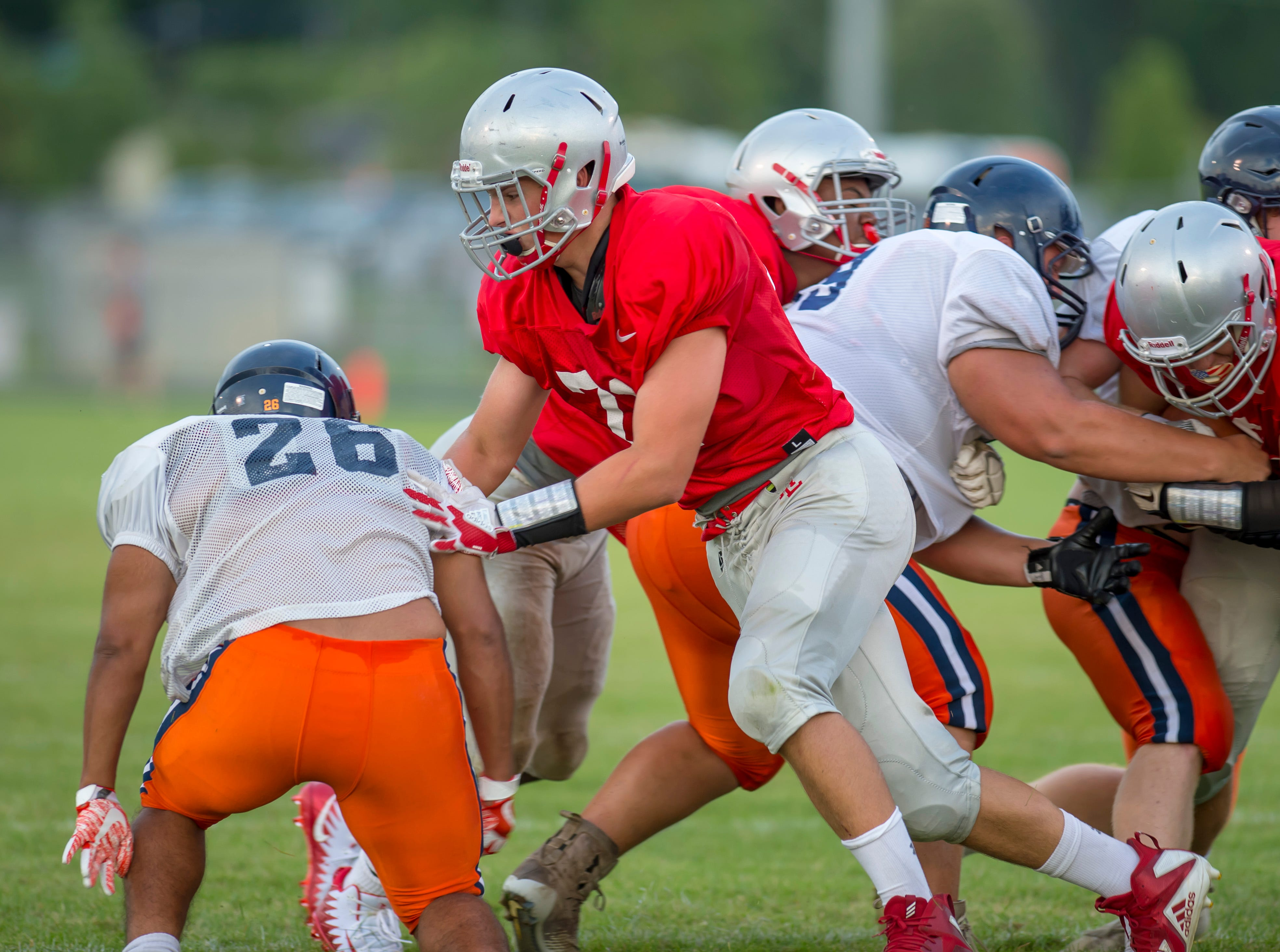 Aidan Sturgeon blocks down during a running play in the football scrimmage between the Harrison Raiders and the West Lafayette Red Devils from Gordon Straley Field