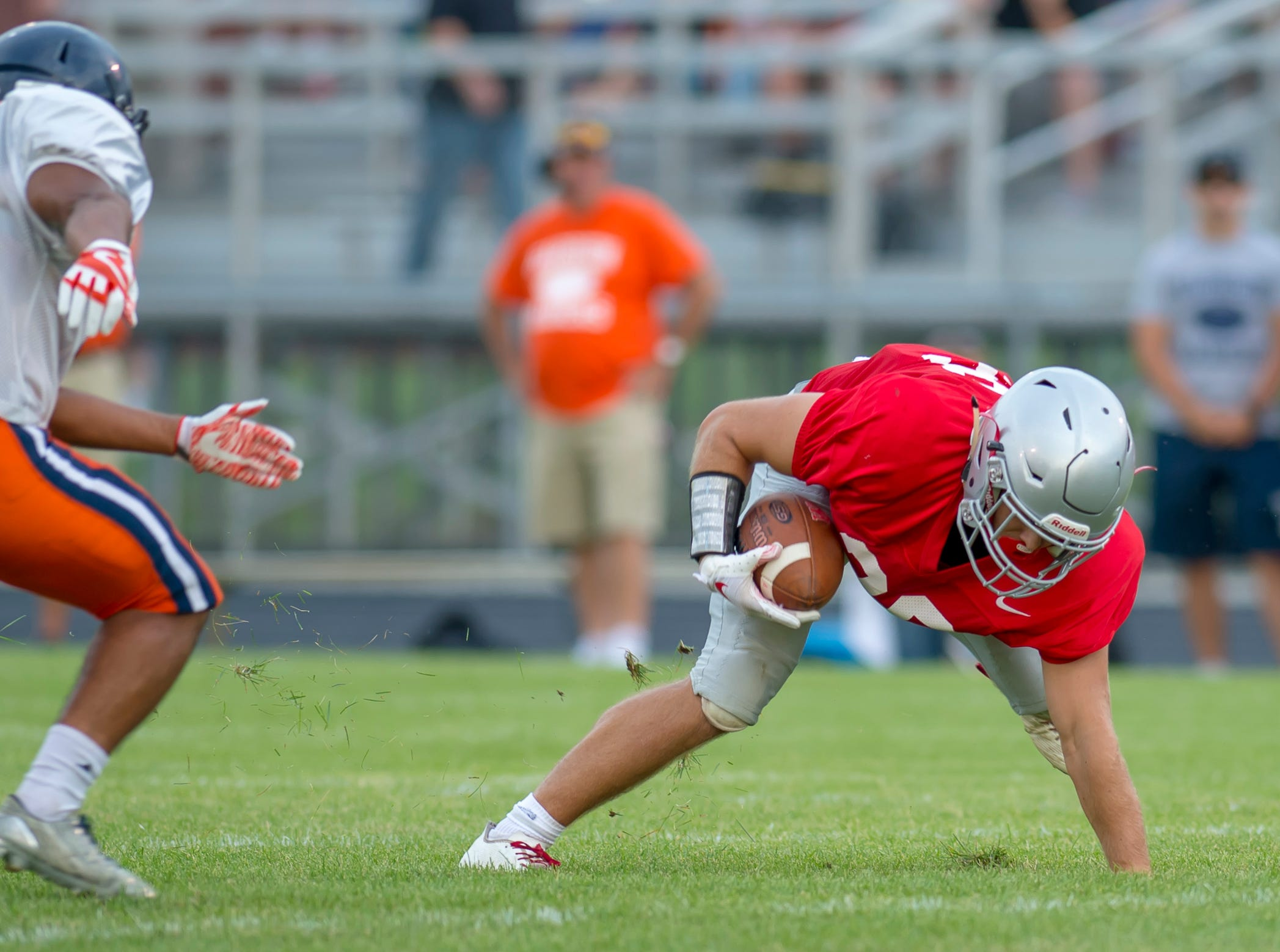 Spencer Blankman regains his balance in the football scrimmage between the Harrison Raiders and the West Lafayette Red Devils from Gordon Straley Field