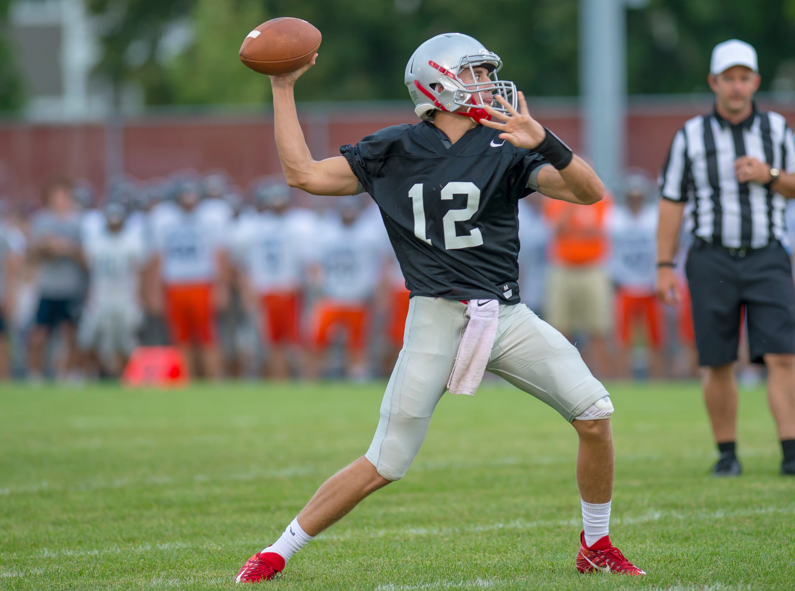 Kyle Adams prepares to launch a bomb in the football scrimmage between the Harrison Raiders and the West Lafayette Red Devils from Gordon Straley Field