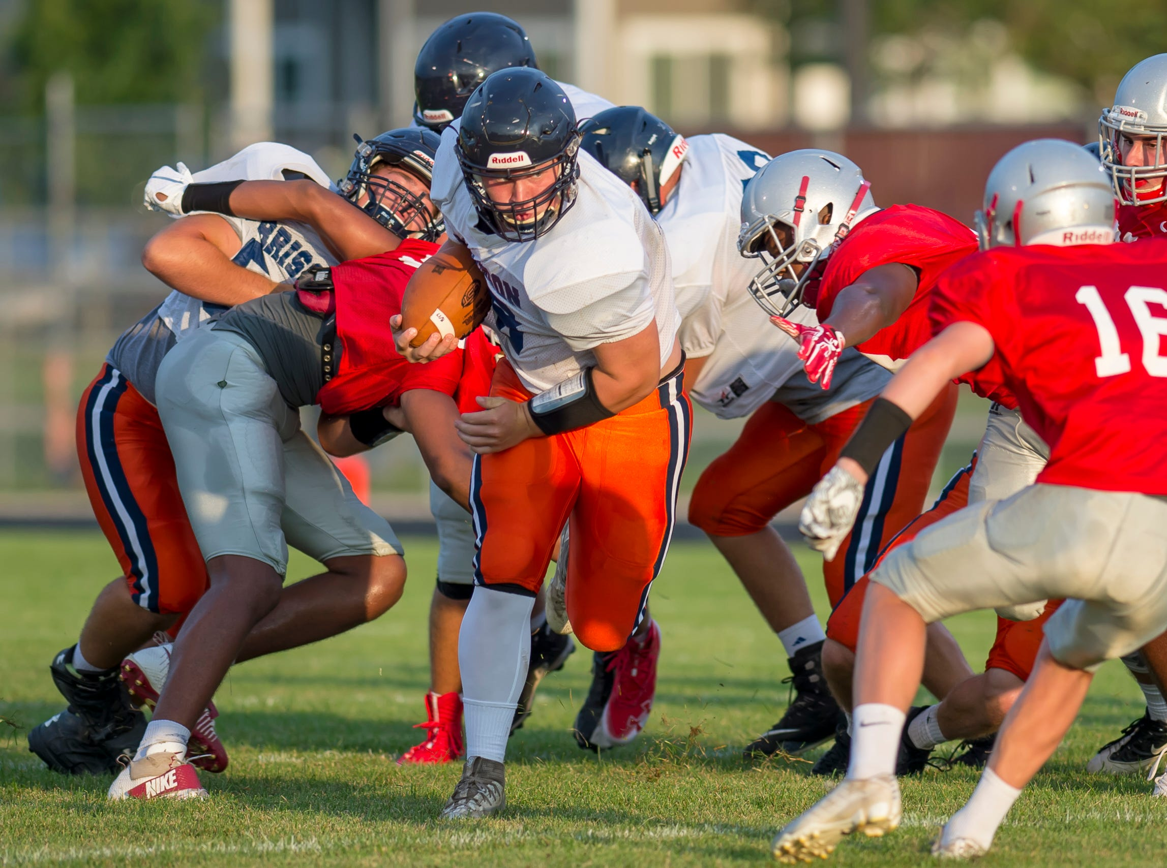 Action from the football scrimmage between the Harrison Raiders and the West Lafayette Red Devils from Gordon Straley Field