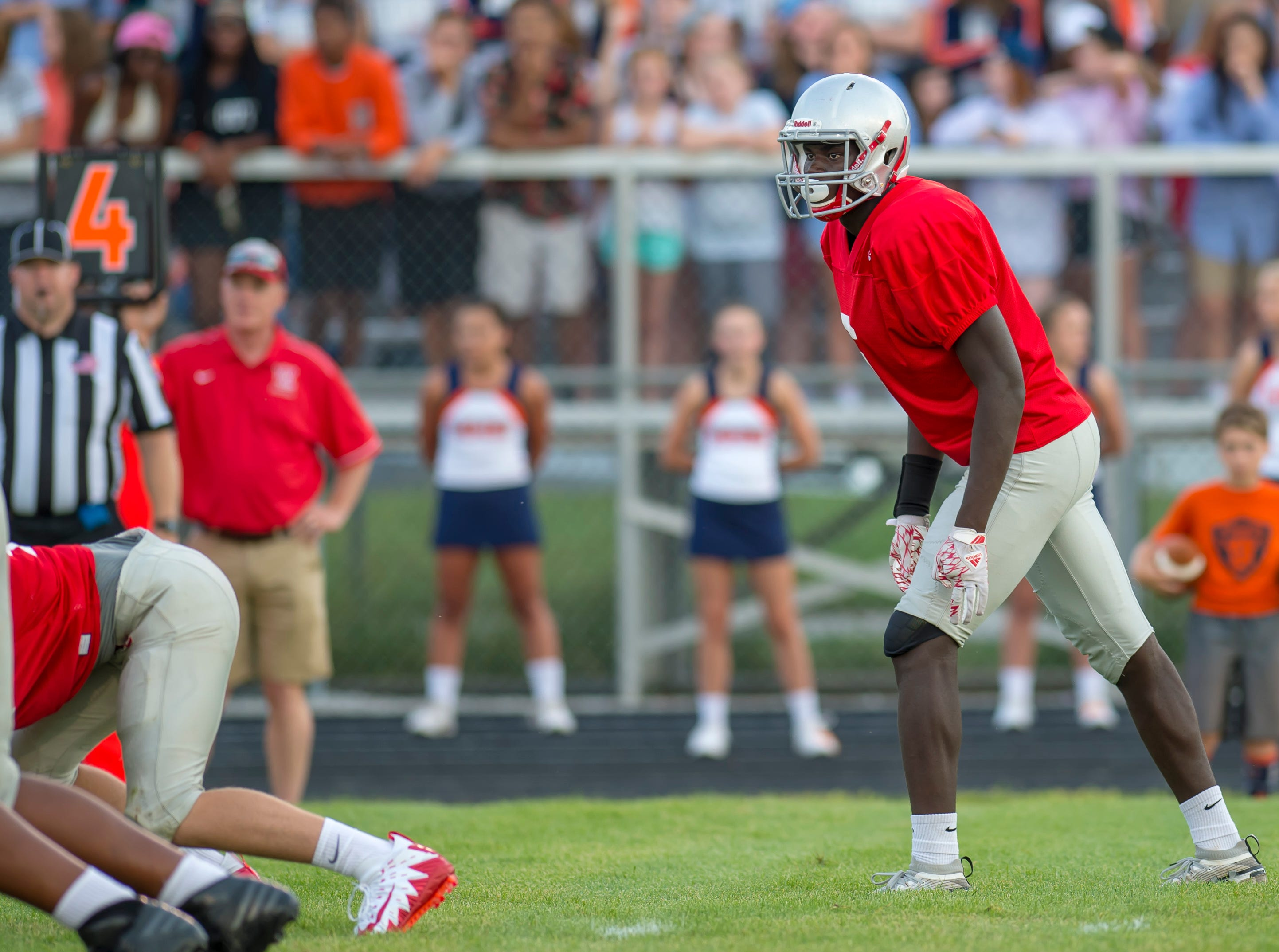 Nelson Mbongo surveys the Harrison backfield in the football scrimmage between the Harrison Raiders and the West Lafayette Red Devils from Gordon Straley Field