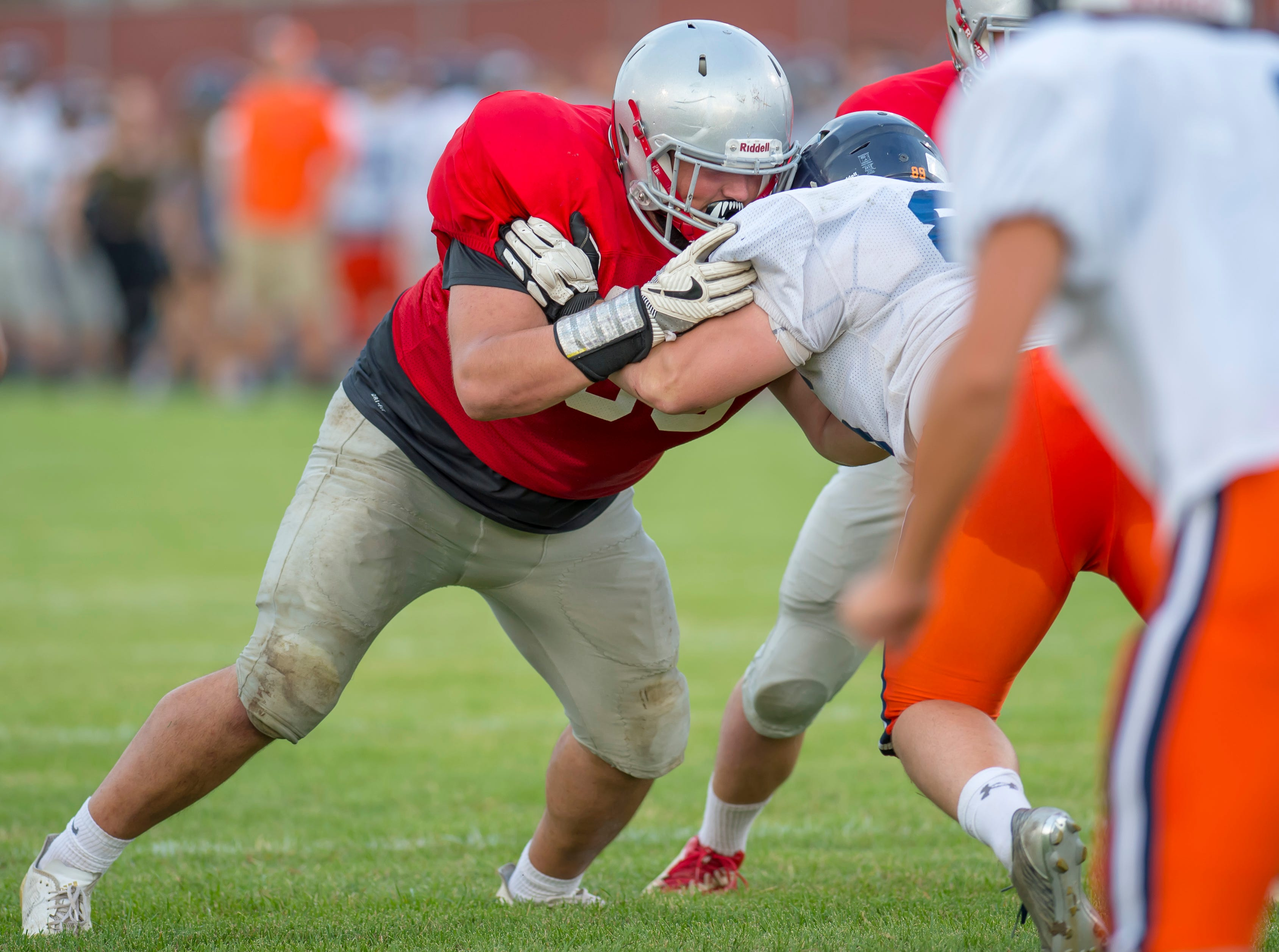 Self Benjamin makes a key block during the football scrimmage between the Harrison Raiders and the West Lafayette Red Devils from Gordon Straley Field