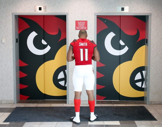 Louisville's Dee Smith waits for an elevator at U of L football media day.