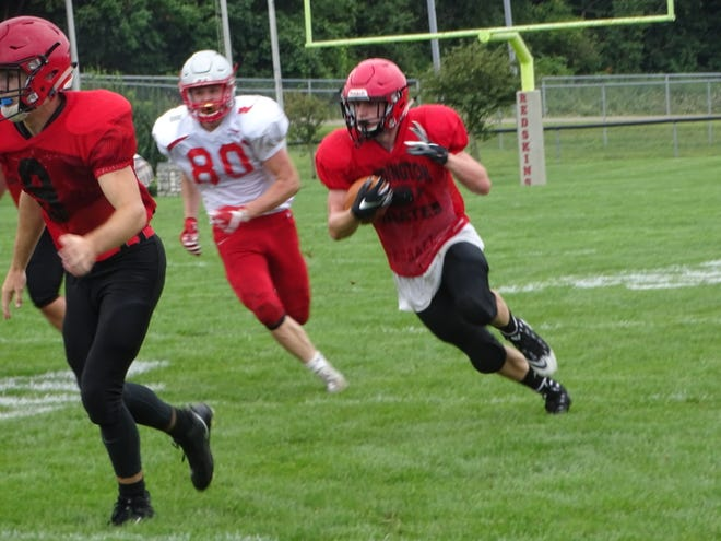 Cardington junior running back Mason Goers carries the ball during a scrimmage at Utica in the preseason. Goers is the team's leading returning rusher.