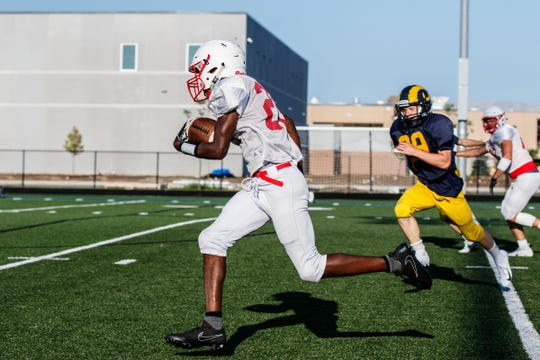 Homestead running back Willie Garrison races down the sideline for a touchdown against Marquette during a multi-team scrimmage Friday at Mukwonago.