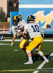 Marquette quarterback Michael McDevitt (10) and running back Daeleon Brown-Williams have helped the Hilltoppers score narrow victories the past two weeks.