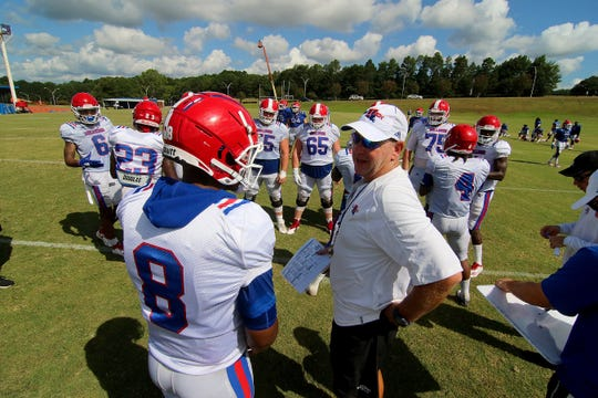Louisiana Tech head football coach Skip Holtz, right, talks with redshirt junior quarterback J'Mar Smith (8) during practice this fall.