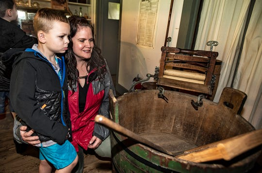 (L-R) Cameron Desch, 4 1/2 and mom Adrienne Desch of Lafayette explore Smith's Canal Store, a general store, at Canal Day at Waterloo Village in Stanhope, August 11, 2018.  Photo by Warren Westura for the Daily Record.