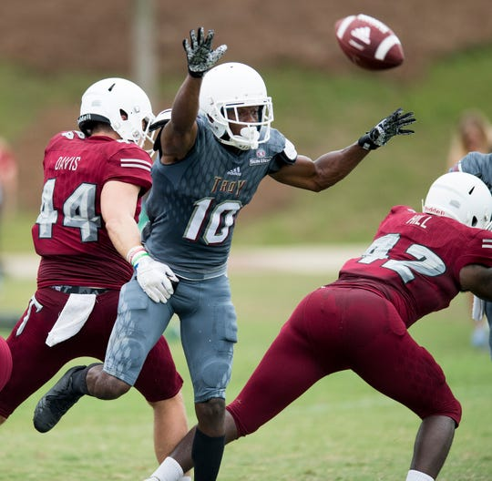 Troy University safety Will Sunderland (10) tries to block a kick during the scrimmage in Troy, Ala. on Saturday August 11, 2018.