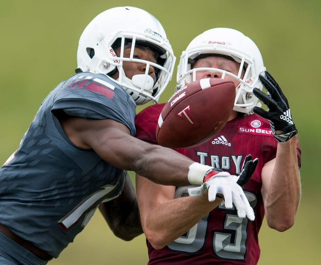 Troy University defender Terence Dunlap, left, breaks up a pass intended for receiver Luke Whittemore during football the scrimmage in Troy, Ala. on Saturday August 11, 2018.