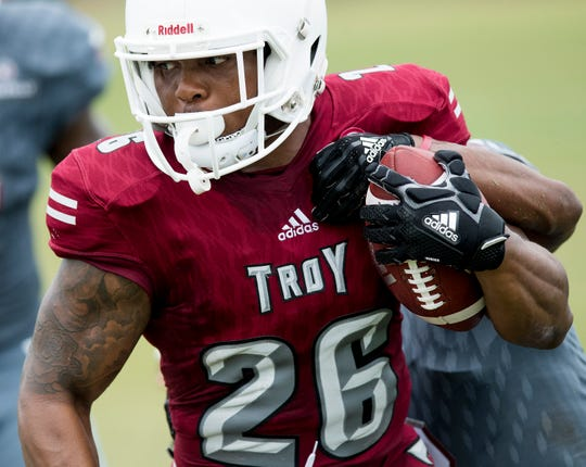 Troy University runningback B.J. Smith carries the ball at the scrimmage in Troy, Ala. on Saturday August 11, 2018.