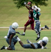 Troy University receiver Damion Willis (15) and defender Terence Dunlap (14) during the scrimmage in Troy, Ala. on Saturday August 11, 2018.
